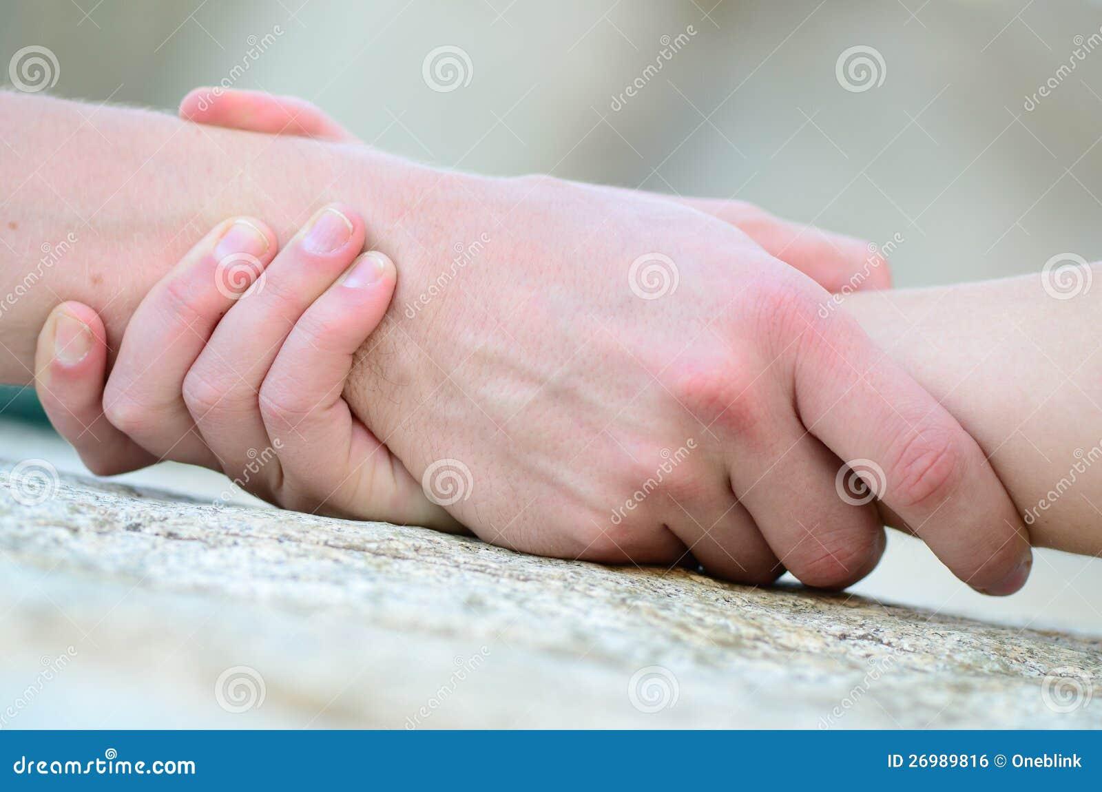 Knäppt fast hand för hjälp