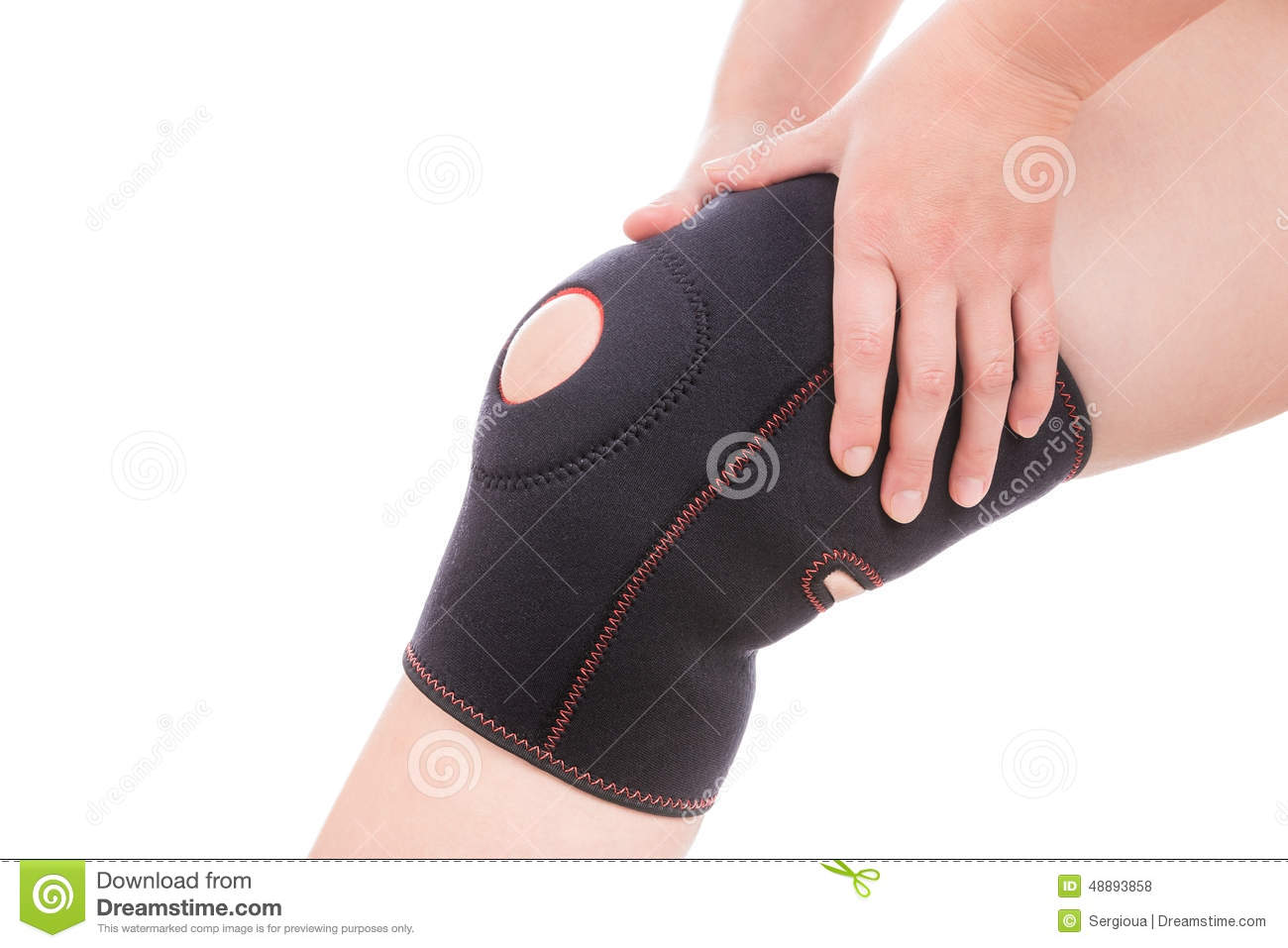 Knee injury. Girl holds hands bandage on his leg.
