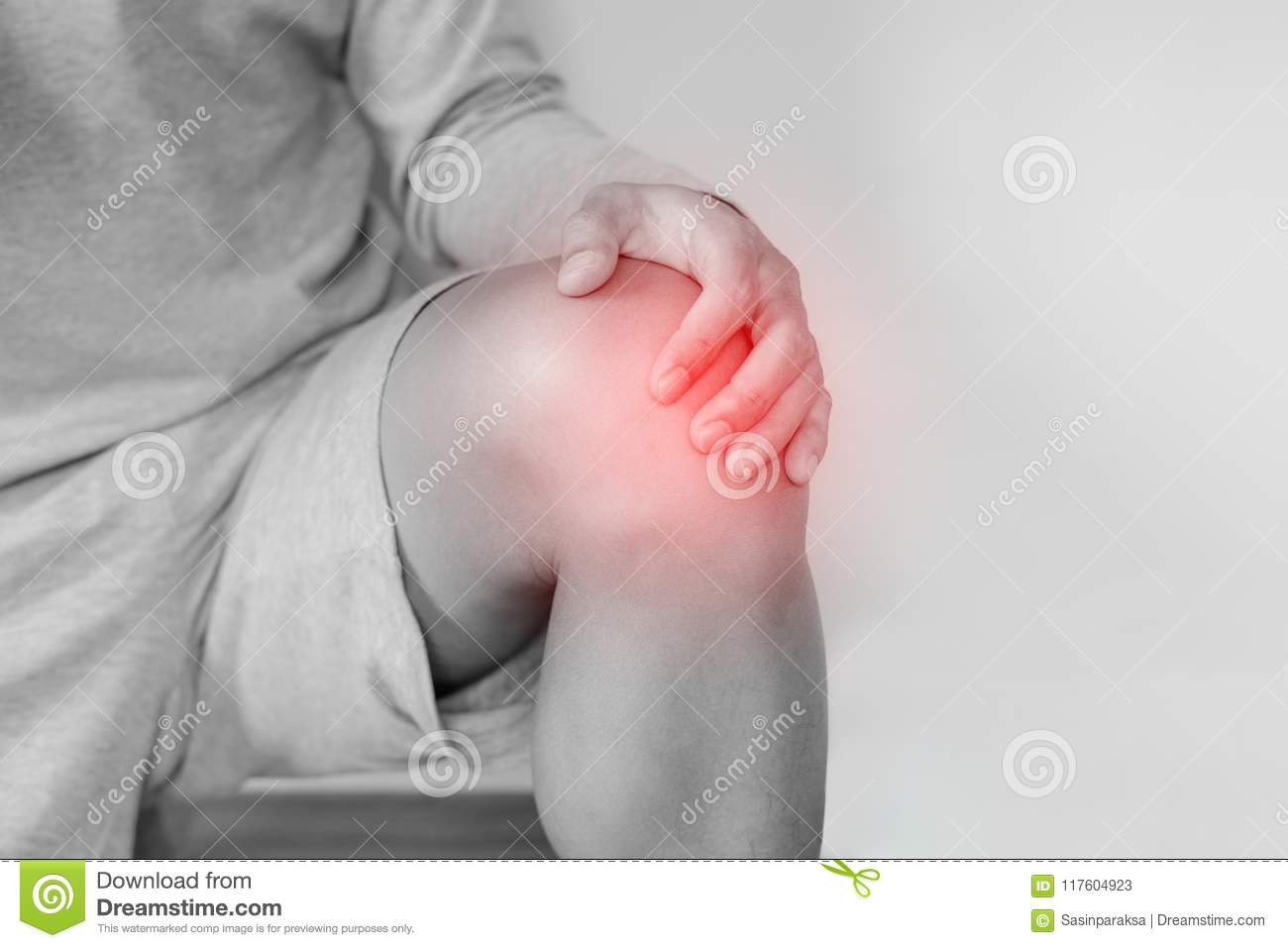 Knee joint pain, a man suffering from knee pain , on white background