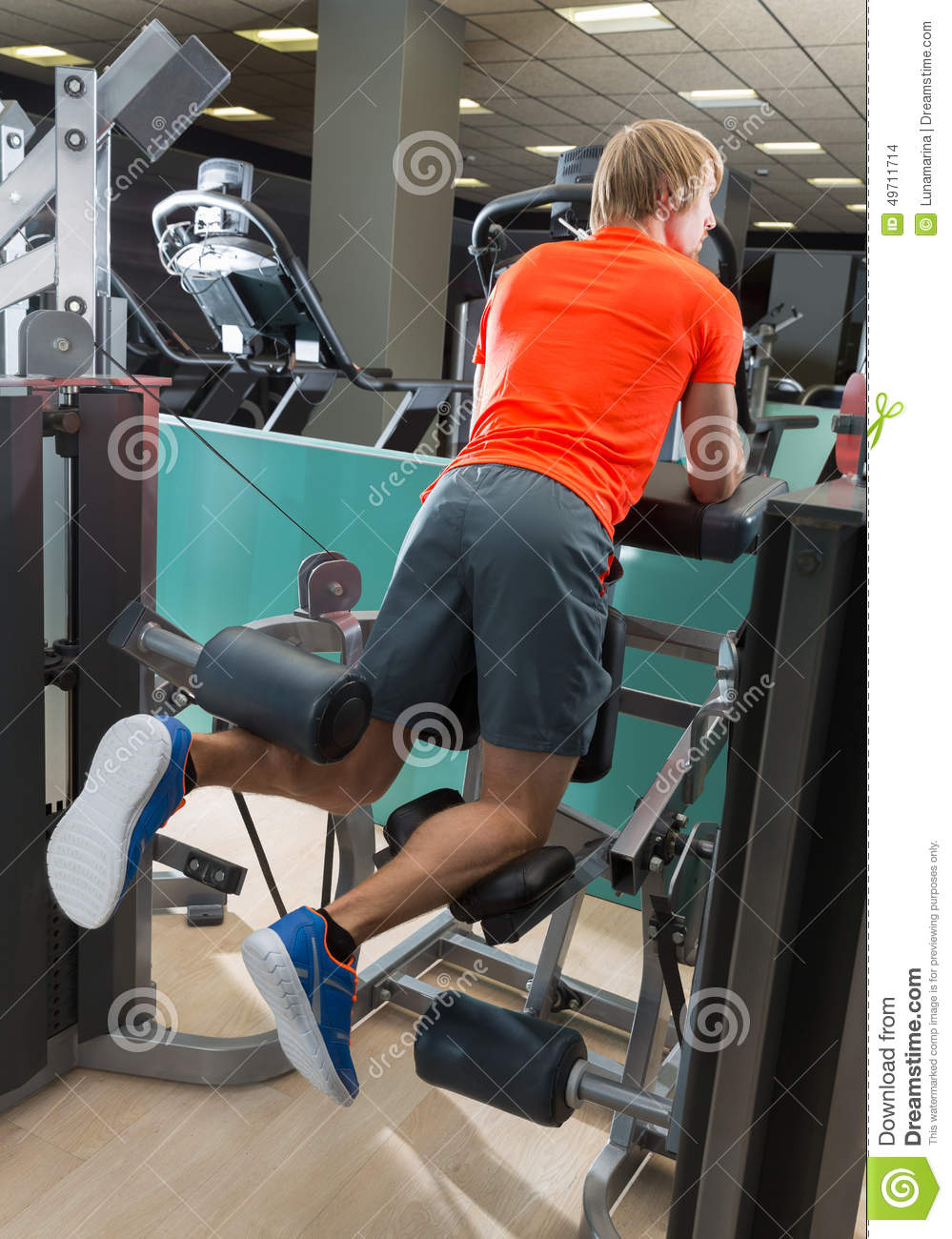 Kneeling Leg Femoral Curl Man At Gym Stock Photo - Image of