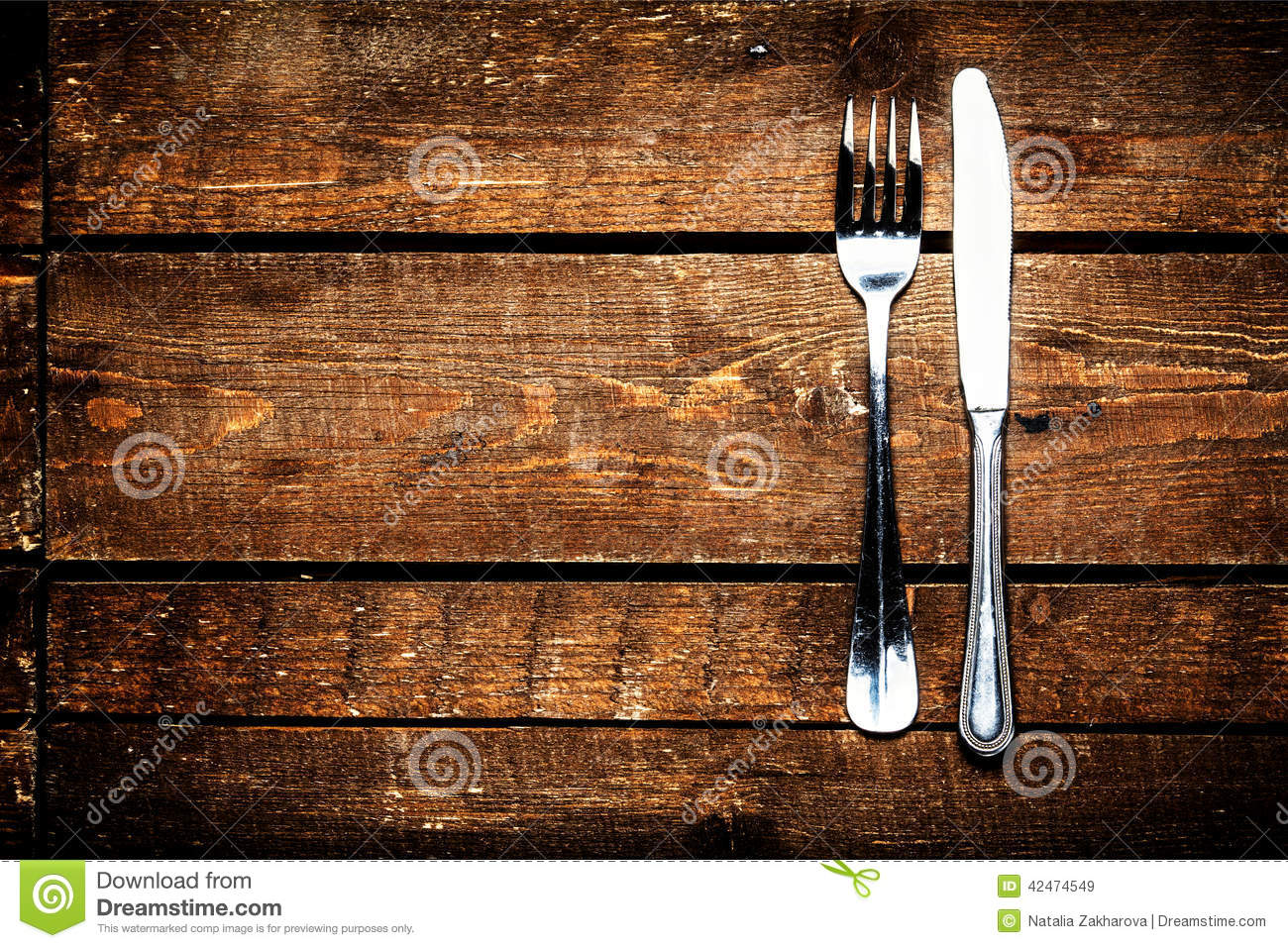 Knife And Fork Over Wooden Table With Copy Space Diet