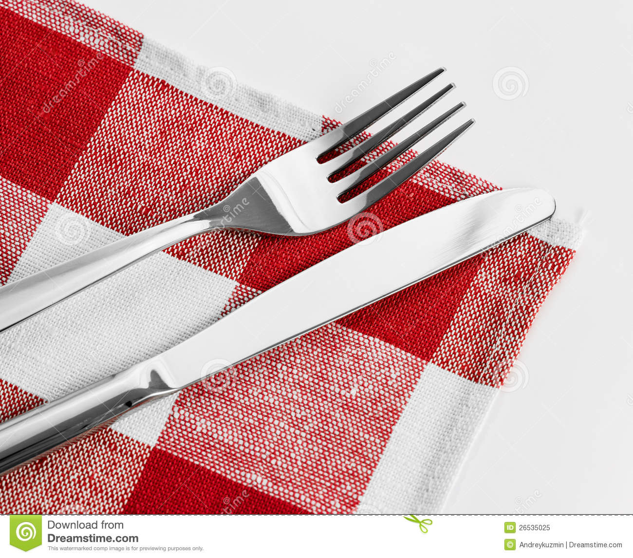 Knife And Fork On Red Checked Tablecloth Stock Image