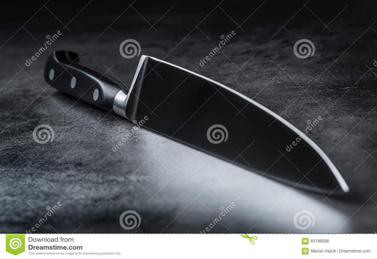 knife kitchen knife lying on an modern concrete cutting board knife kitchen knife lying on an modern concrete cutting board stock photo