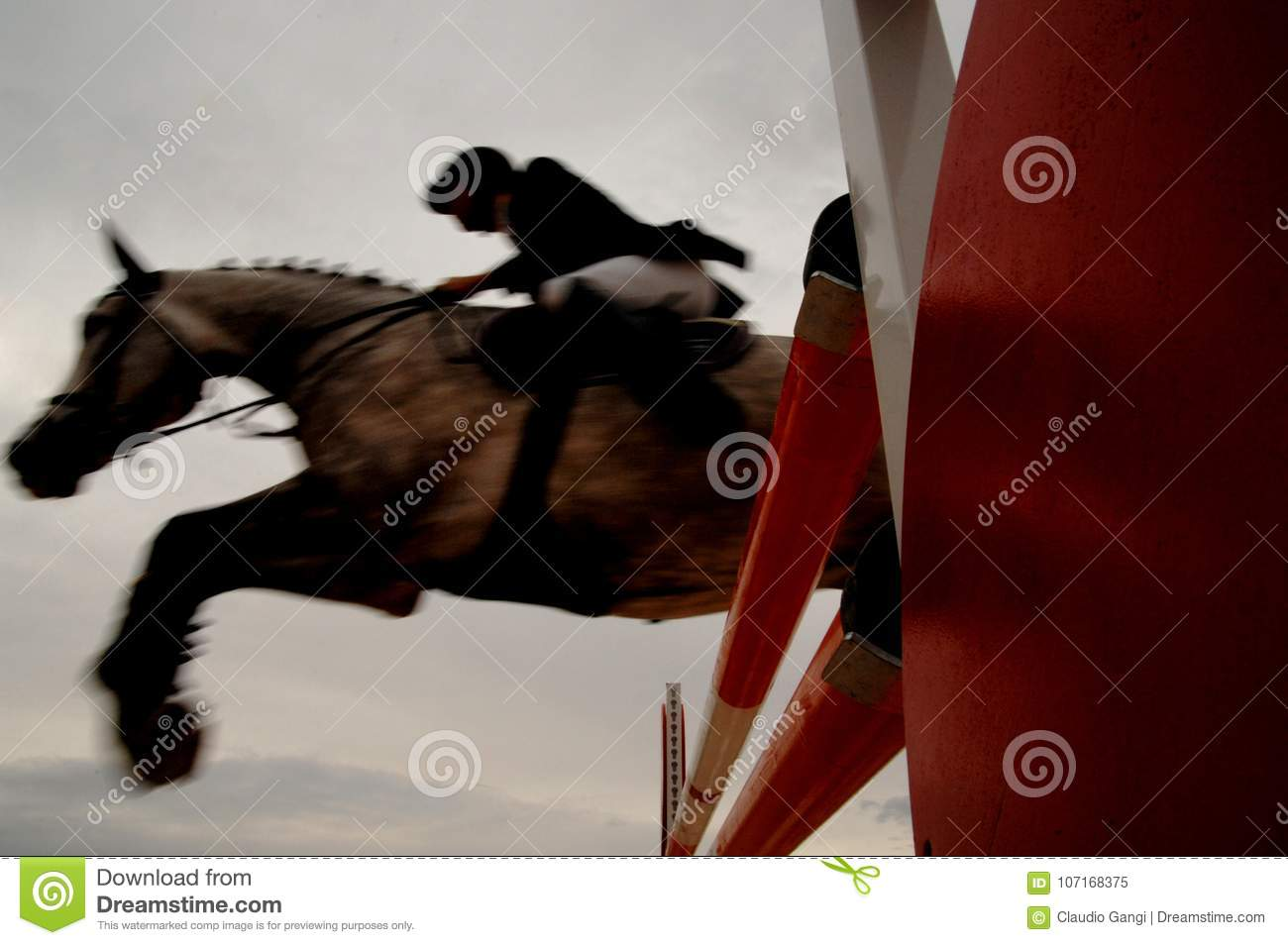 Knight jumps obstacle with horse