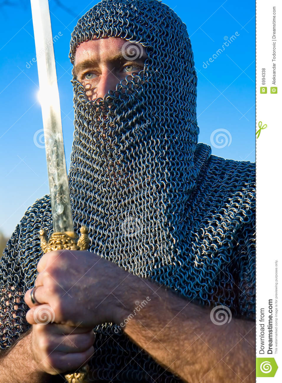 Knight Wearing Armour And Hold On A Sword Stock Photo ...