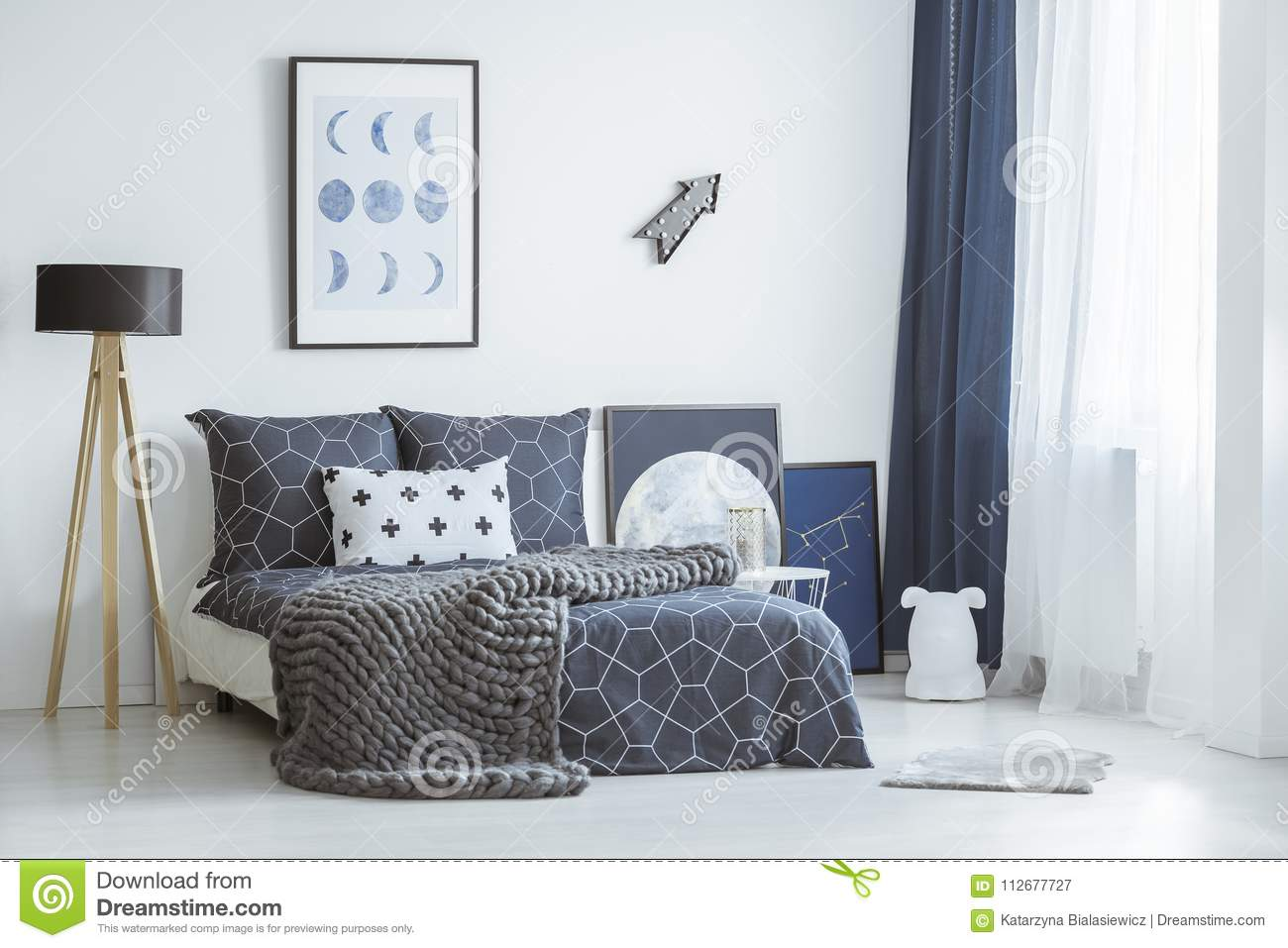 Poster In Patterned Bedroom Interior Stock Image - Image of phases ...
