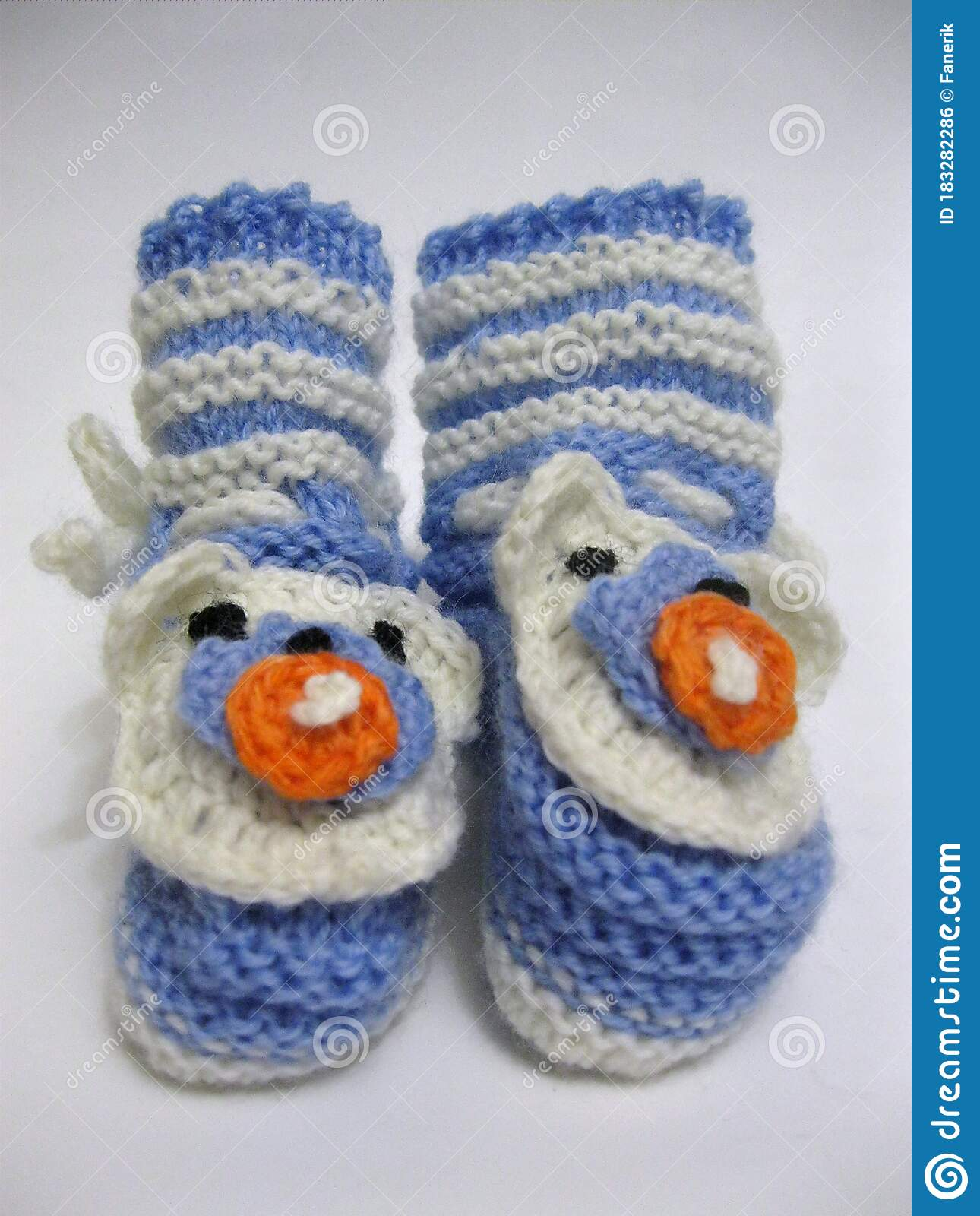 Knitted Booties With Knitting Needles
