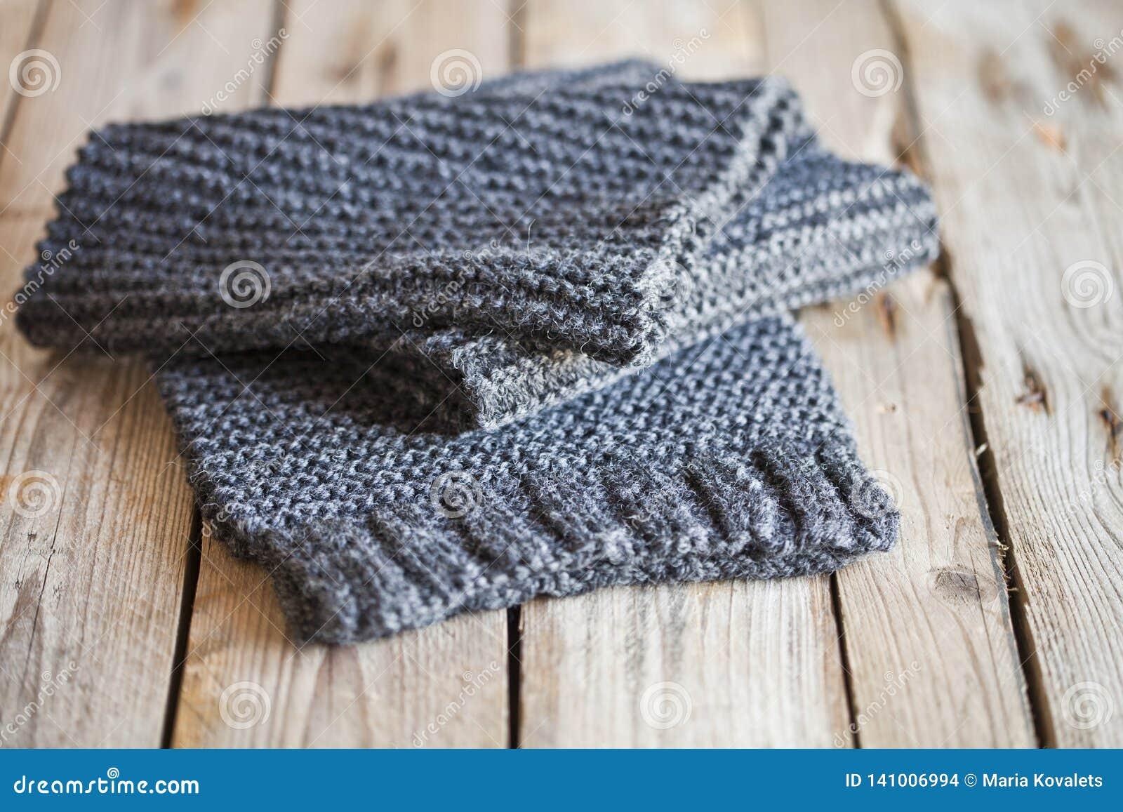 Knitted dark grey scarf