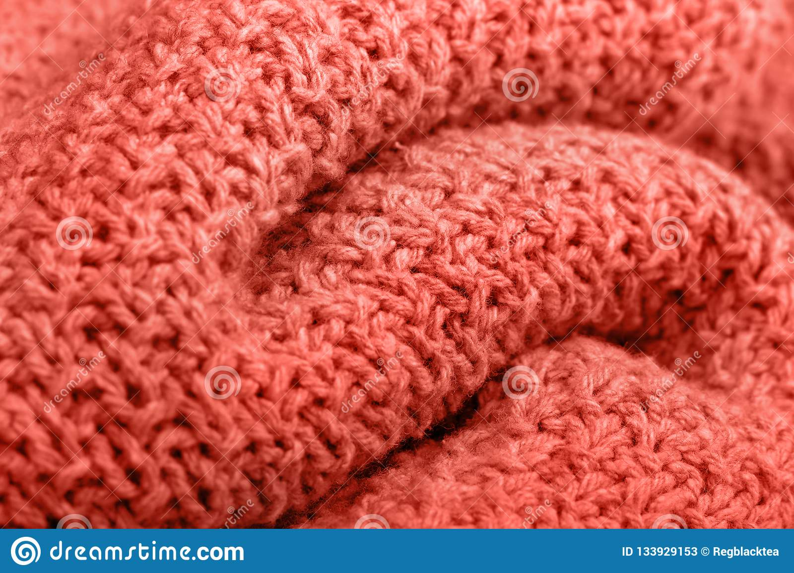 Knitted fabric texture living coral color.