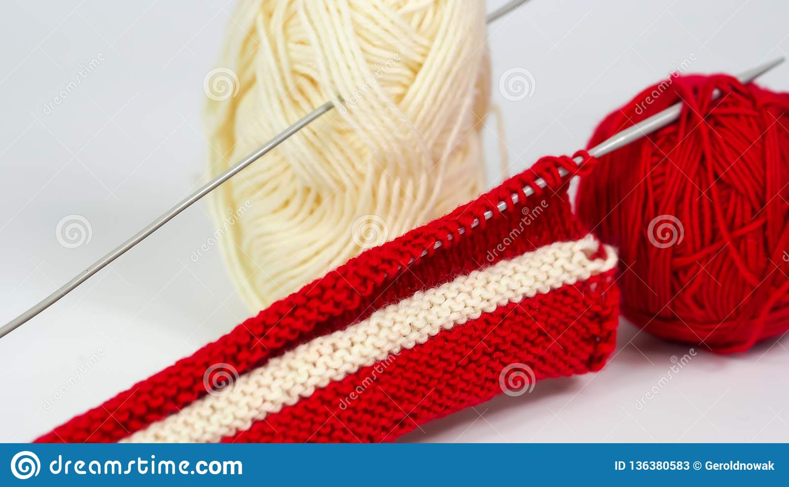Knitted piece of white and red wool