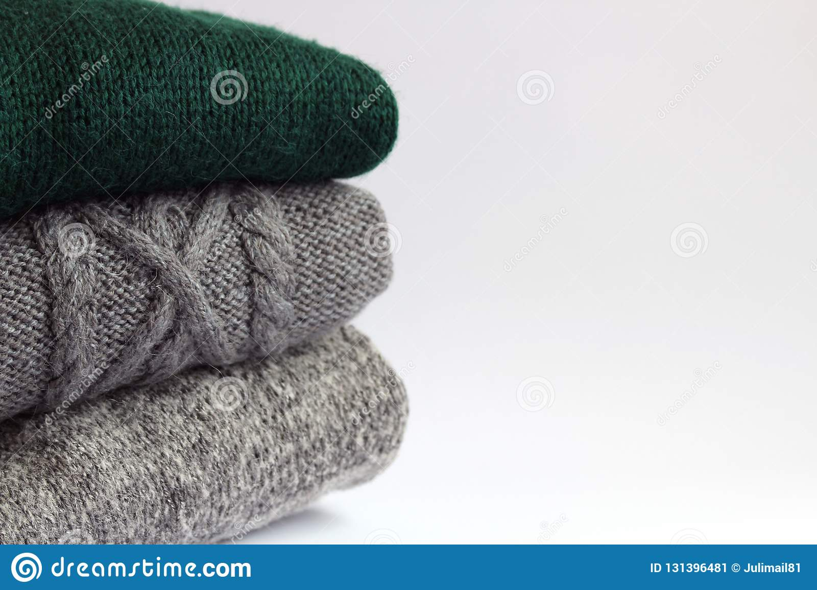 Knitted Woolen Sweaters On A Light Background Stock Image