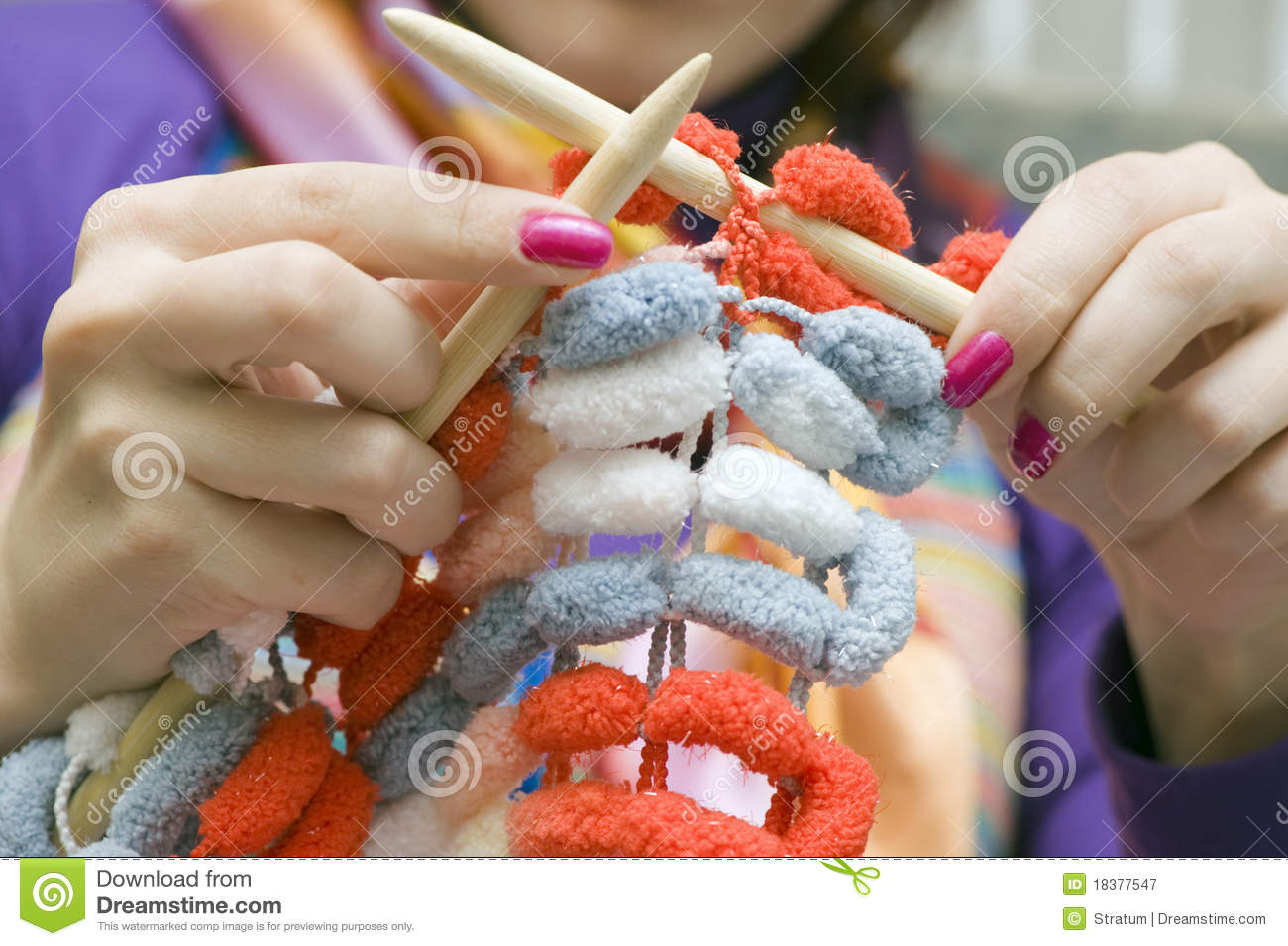 Knitting Arthritis : Hands knitting a magenta scarf stock photography