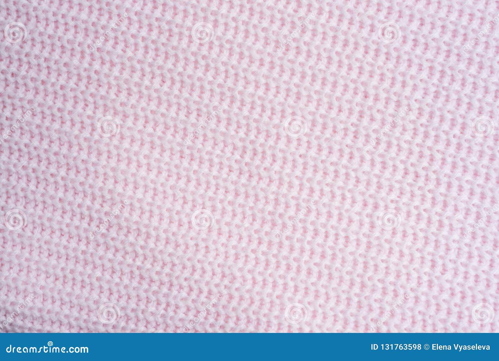 Knitting Het gestreepte roze breit stoffentextuur, gebreide patroonachtergrond Het vastzetten met roze gebreide plaid De ruimte v