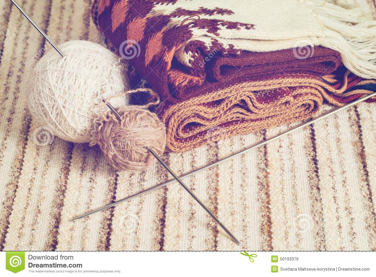 knitting needles and yarn on rustic stock photo image
