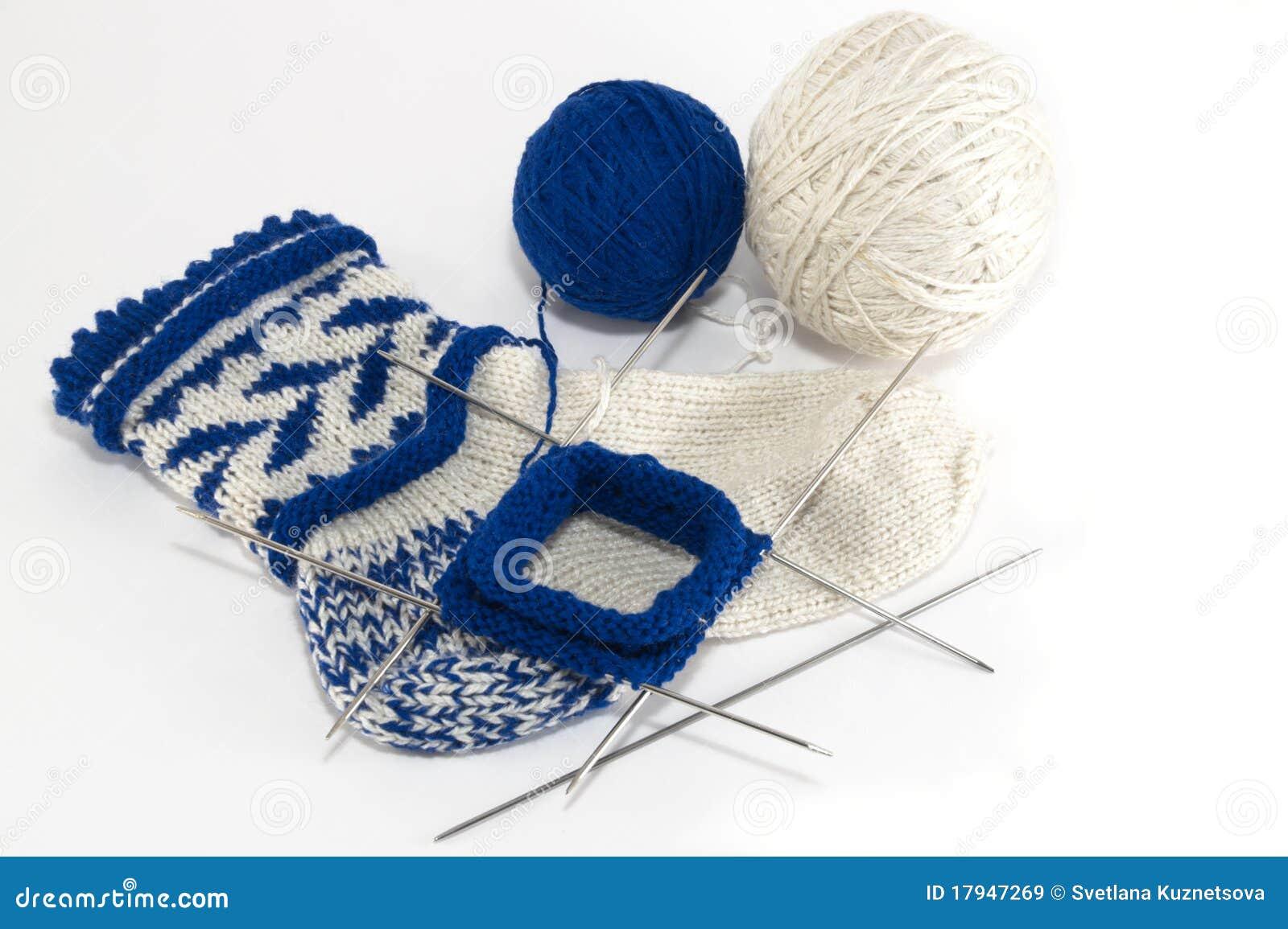 Knitting Pattern For Socks On Five Needles : Knitting Socks Royalty Free Stock Images - Image: 17947269