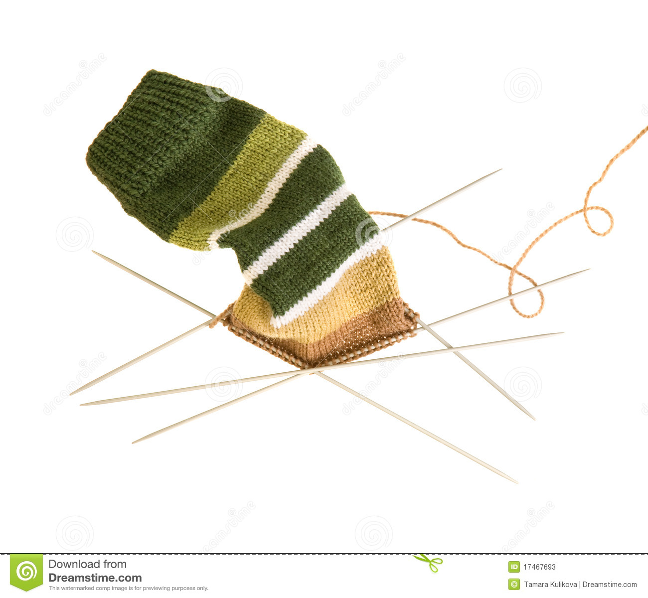 Knitting Pattern Socks Four Needles : Knitting A Striped Sock On Five Needles Stock Photos - Image: 17467693