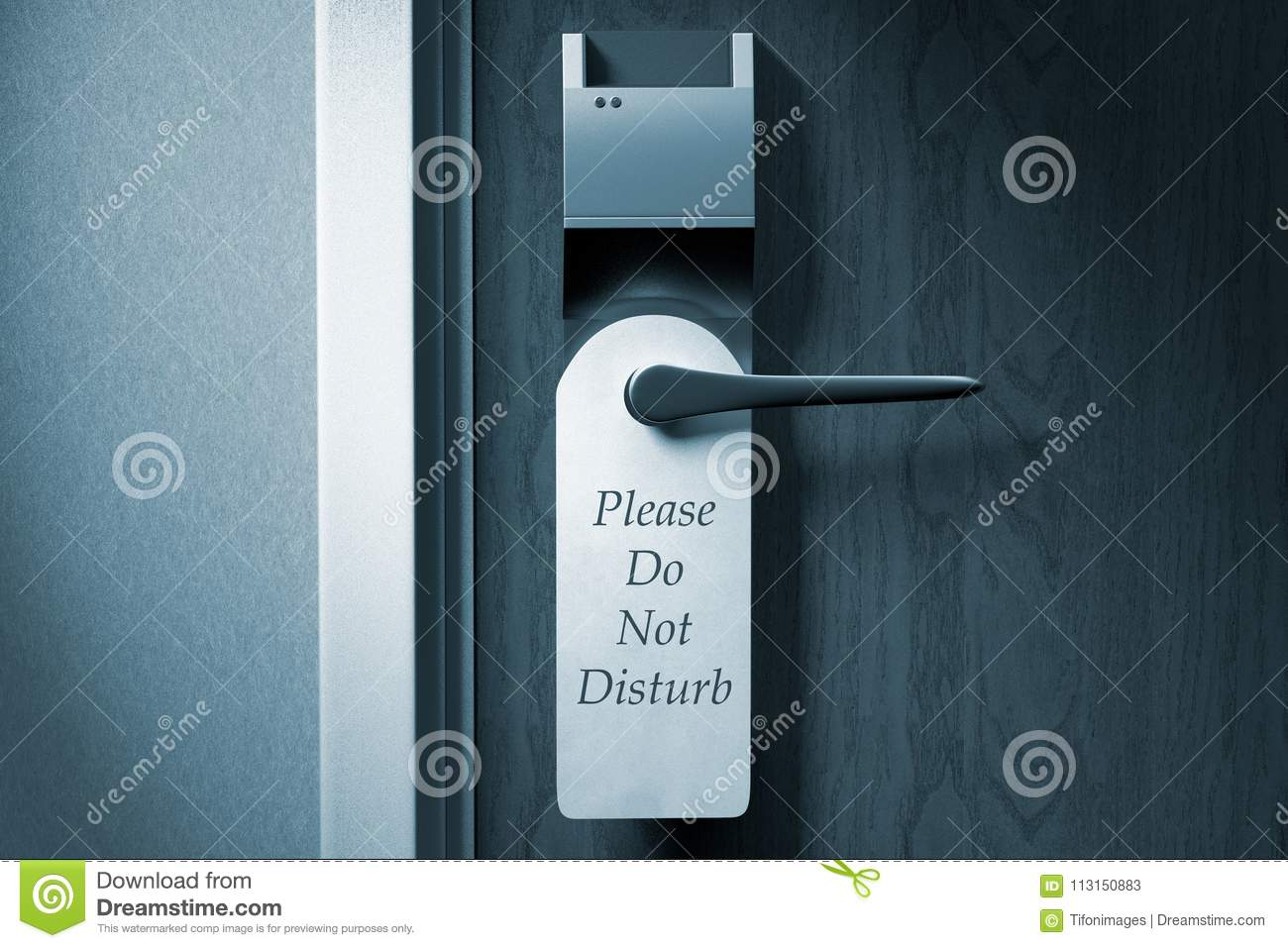 A knob of a hotel door with `Please do not disturb` tag