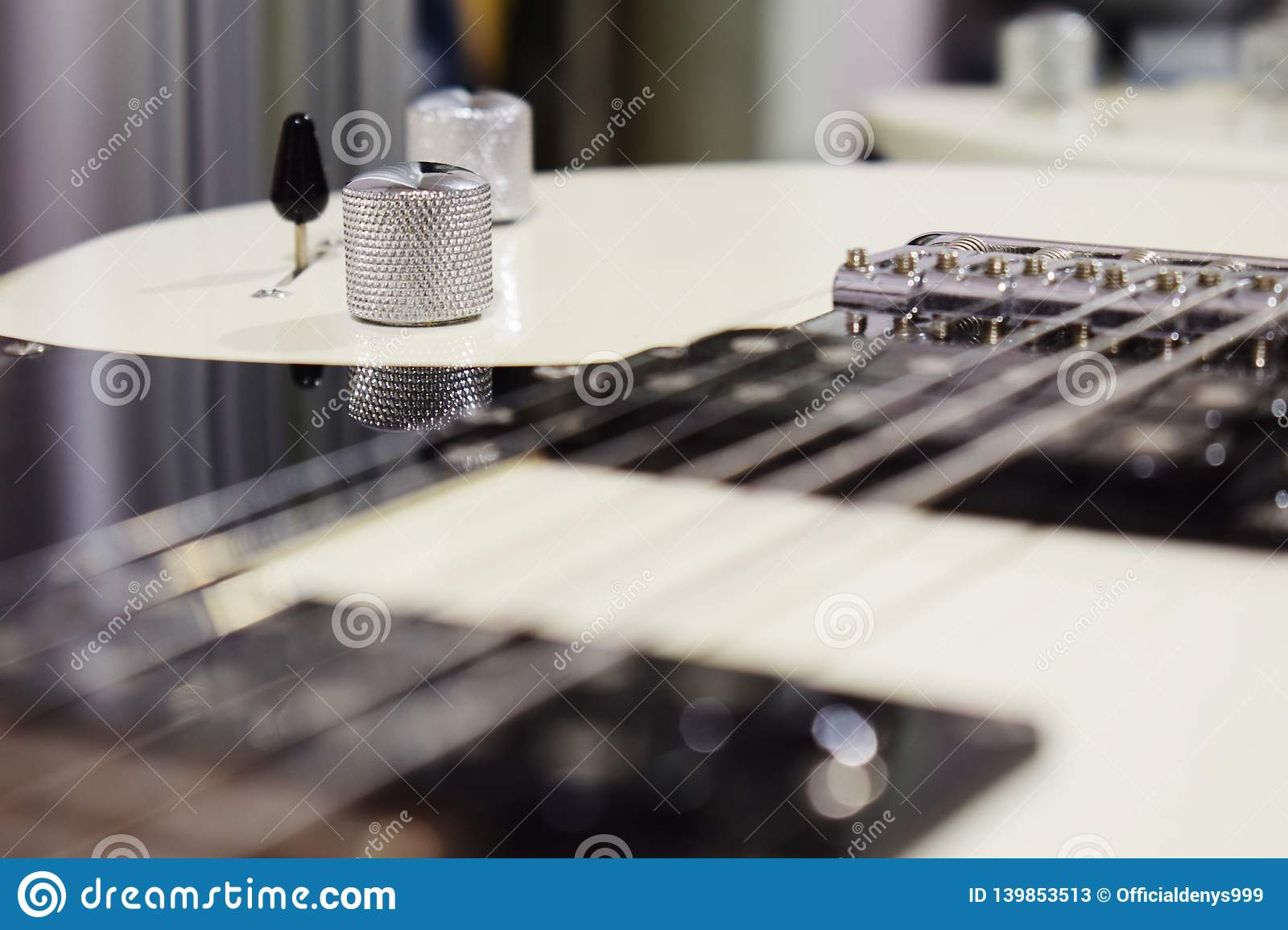 Knobs on a electric guitar, part of an electric guitar