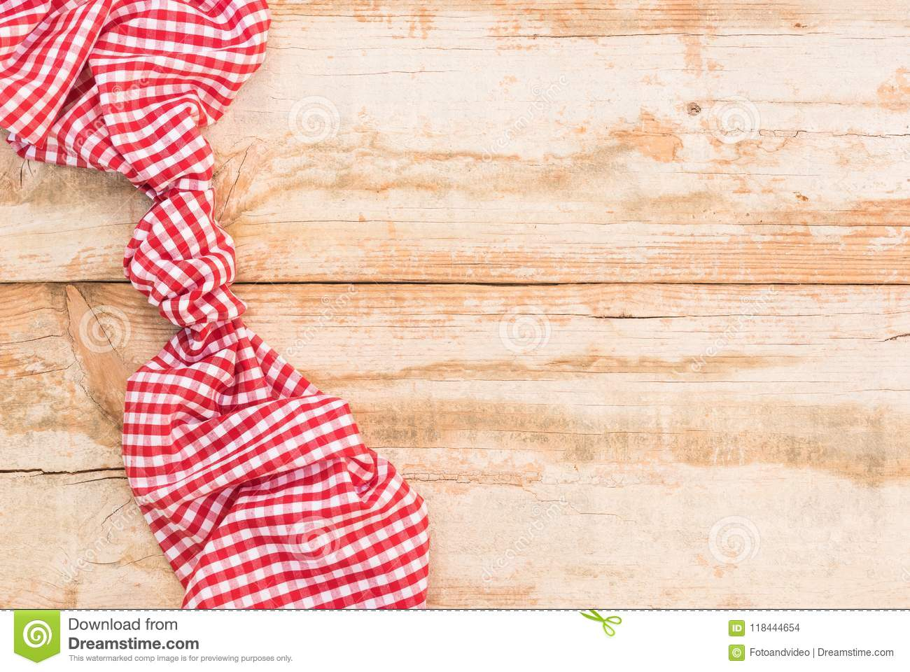 empty rustic wooden picnic table background covered with red checked
