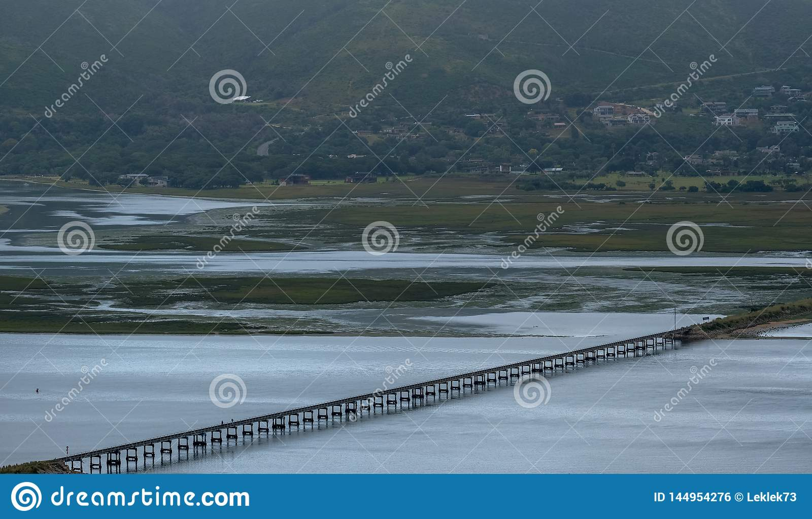 Knysna, South Africa: water in the estuary at Knysna Lagoon, with bridge carrying train lines running across the water.