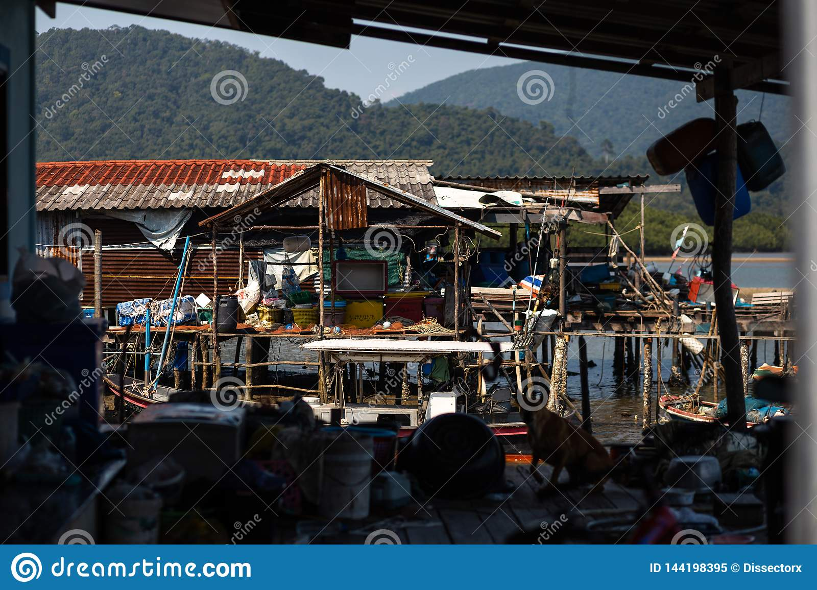 KO CHANG, THAILAND - APRIL 10, 2018: Authentic traditional fishermen`s village on the island - People and children in