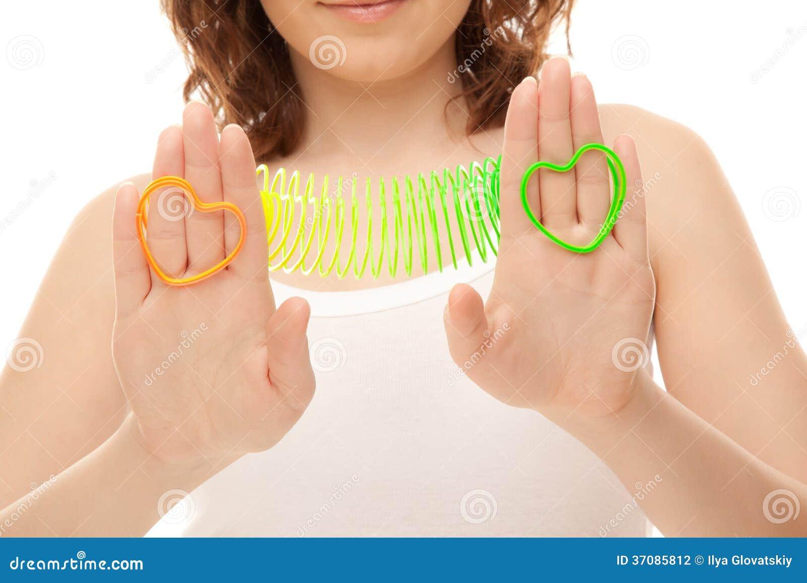 Download Kobieta Z Serce Kształtować Zabawkami Zdjęcie Stock - Obraz złożonej z nowożytny, pozytyw: 37085812