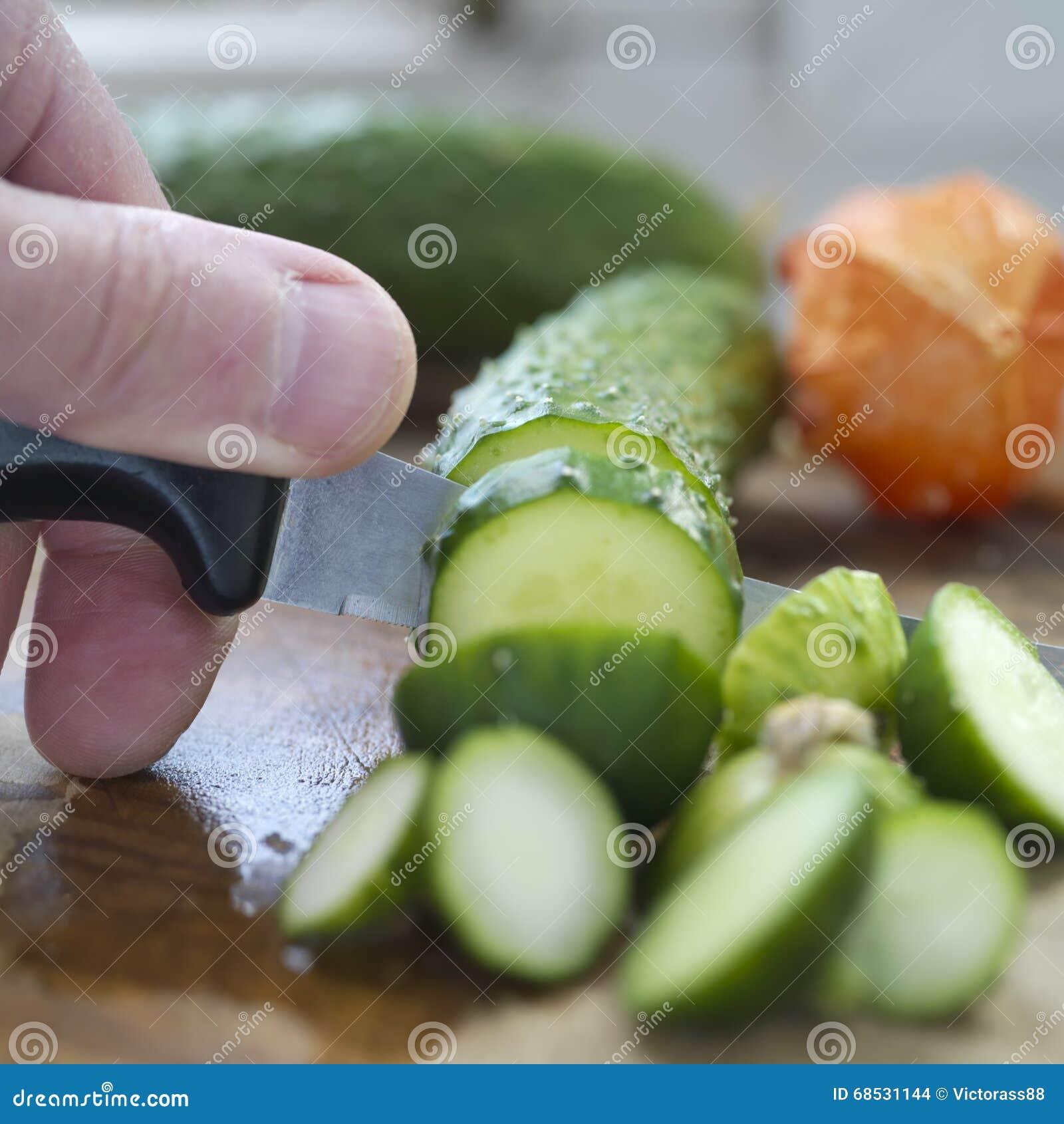 Kock Chopping Cucumber