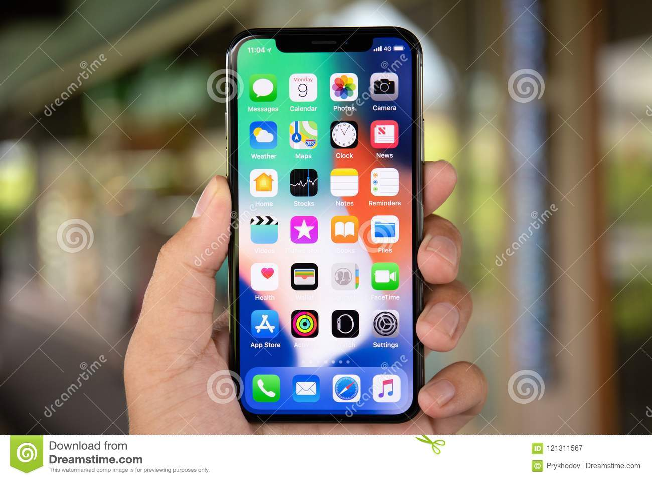 Man Hand Holding Iphone X With Ios 11 On Screen Editorial