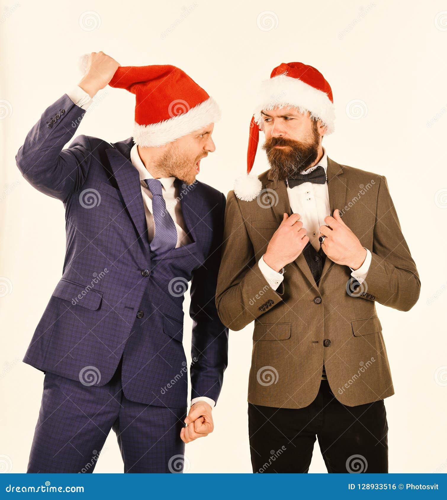 Koledzy z brodami dyskutują o biznesie świętuje świętowania bożych narodzeń córki kapeluszy macierzysty Santa target2744_0_