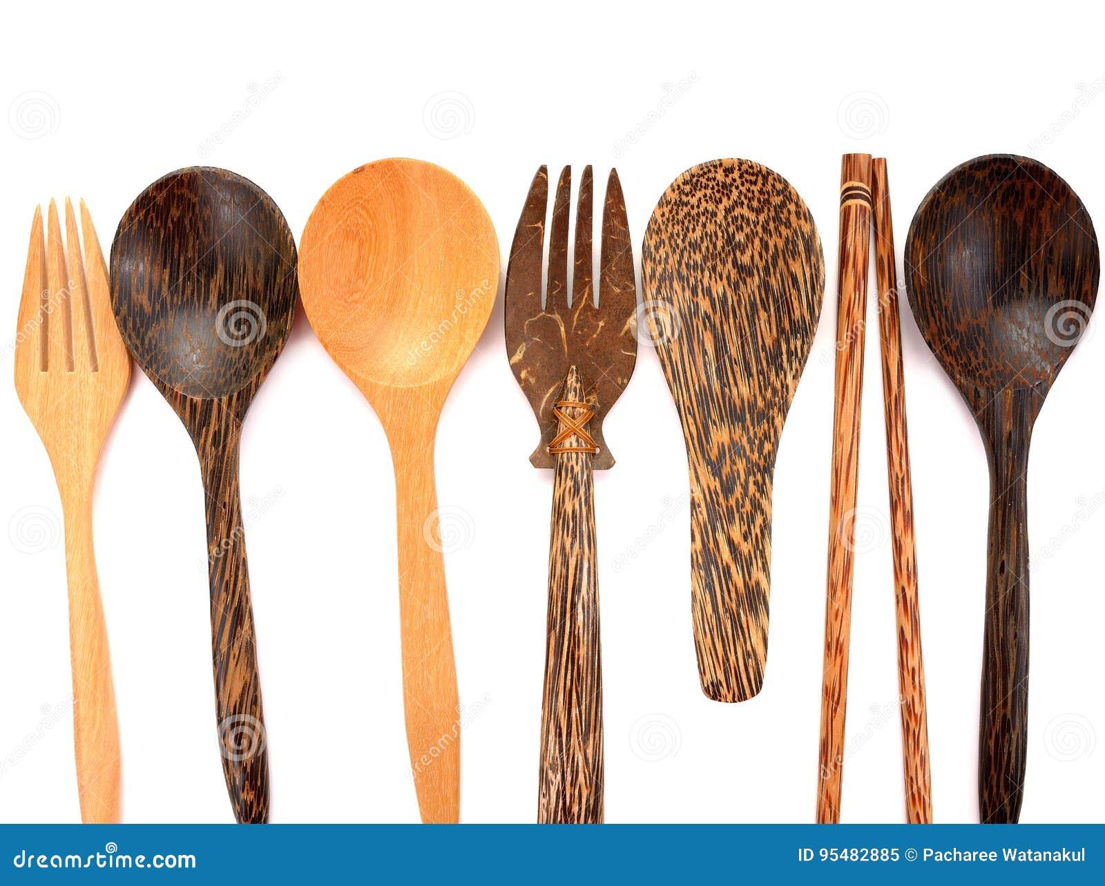 Kolekcja drewniani kuchenni naczynia odizolowywający na białym tle