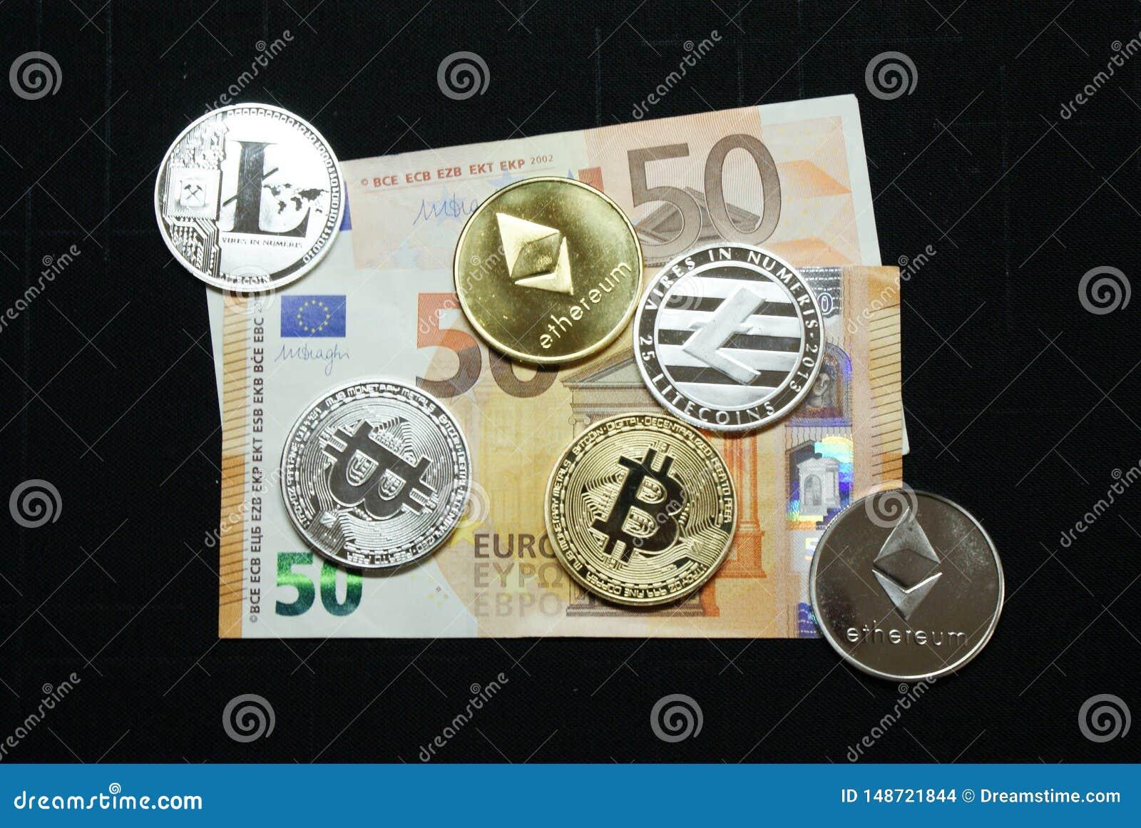 Kolekcja srebne i złociste cryptocurrency monety na 50 euro banknocie