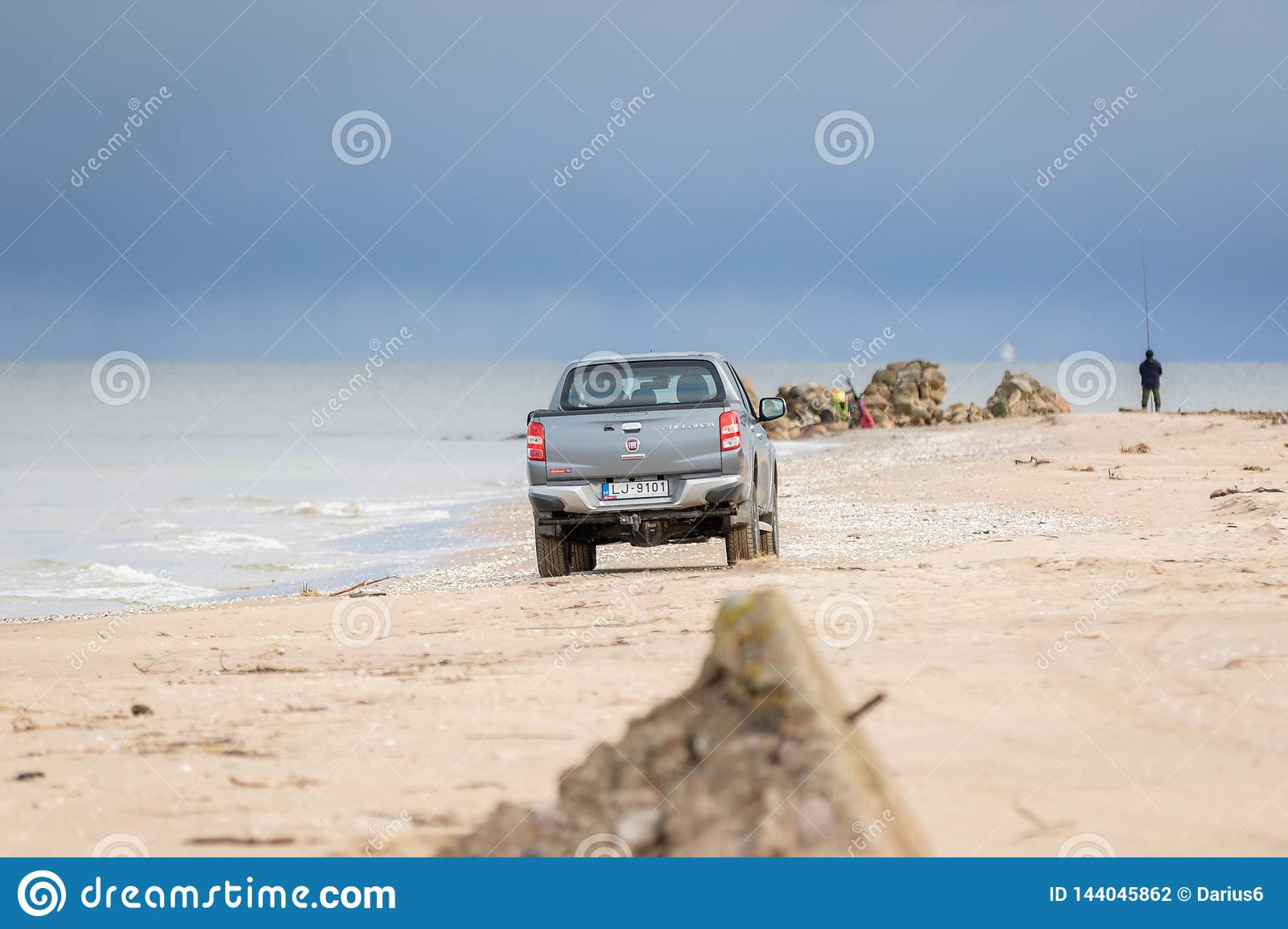 KOLKA, LATVIA - 26 OCTOBER 2018: Fiat Fullback pick up truck driving in the beach