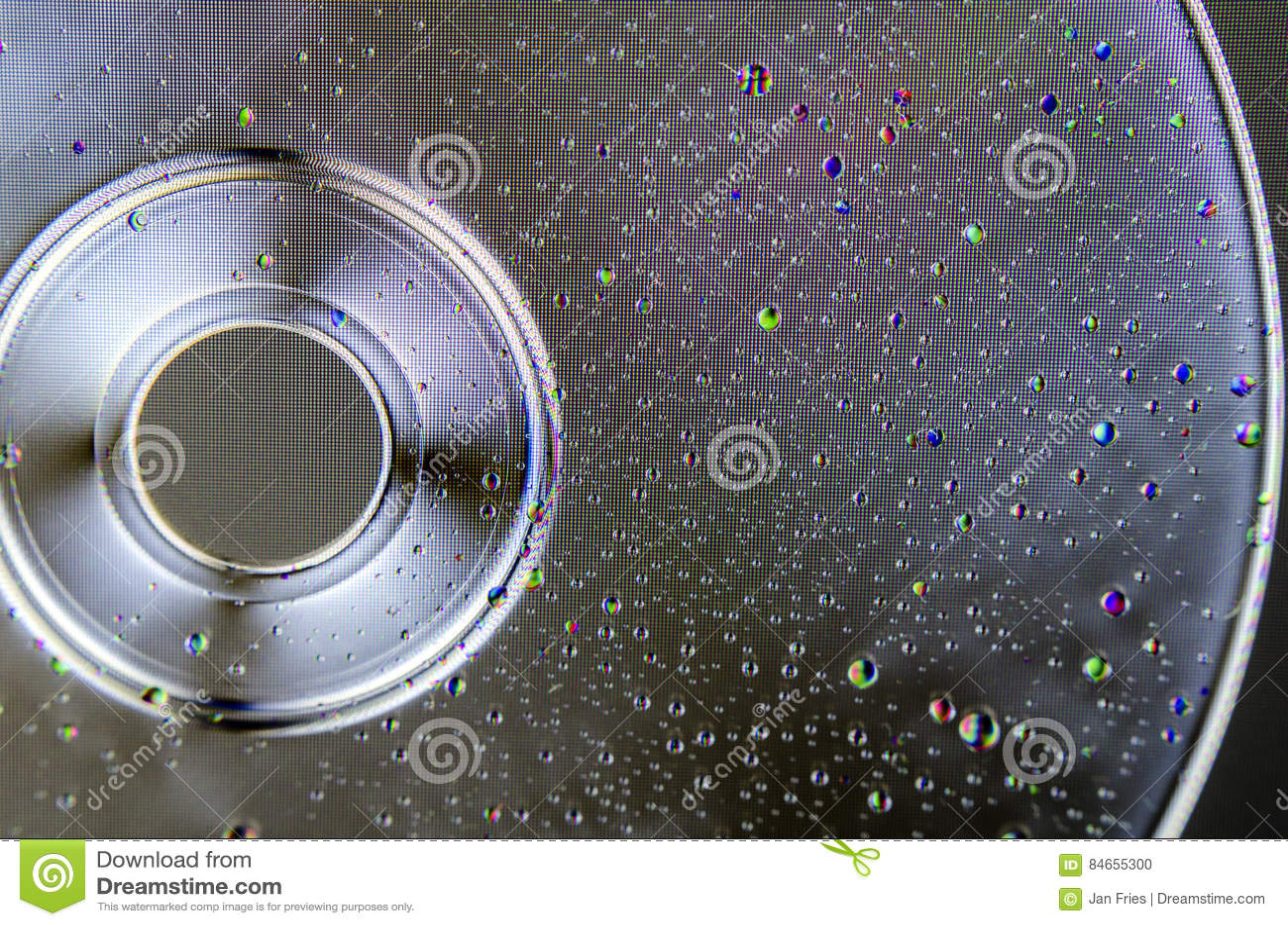 Kolorowa woda opuszcza na polaryzującym cd lub DVD