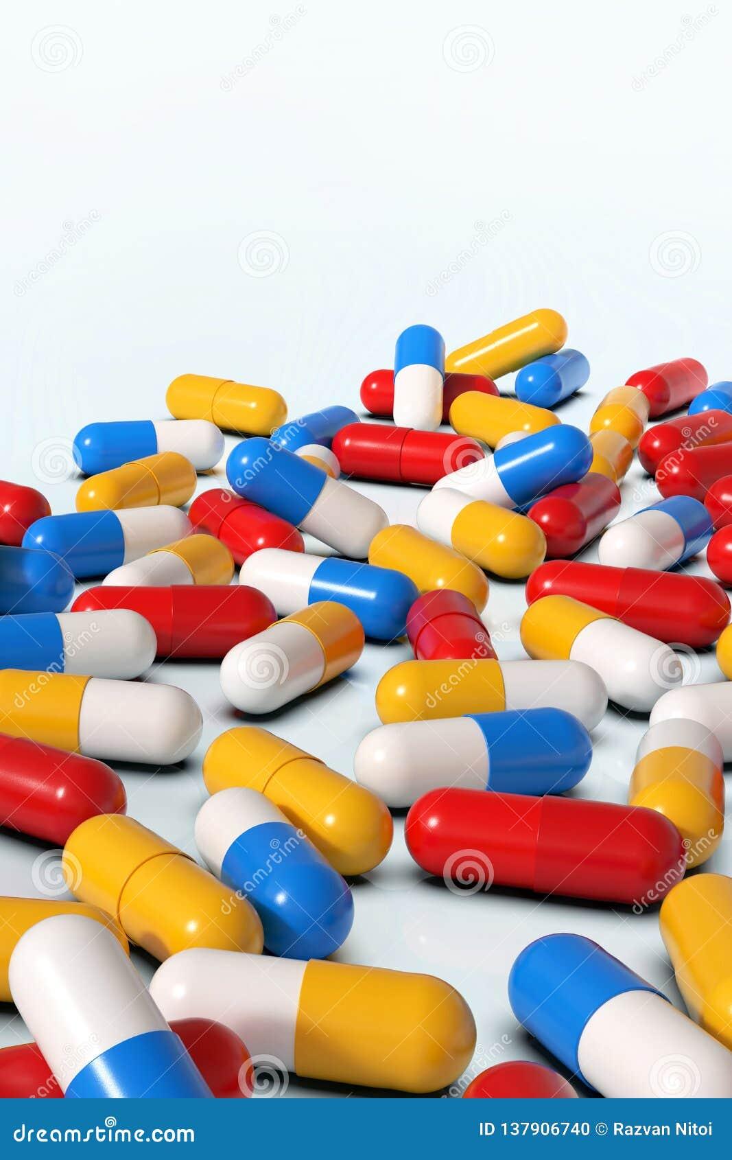 Kolorowe medycyn kapsuły na białym tle