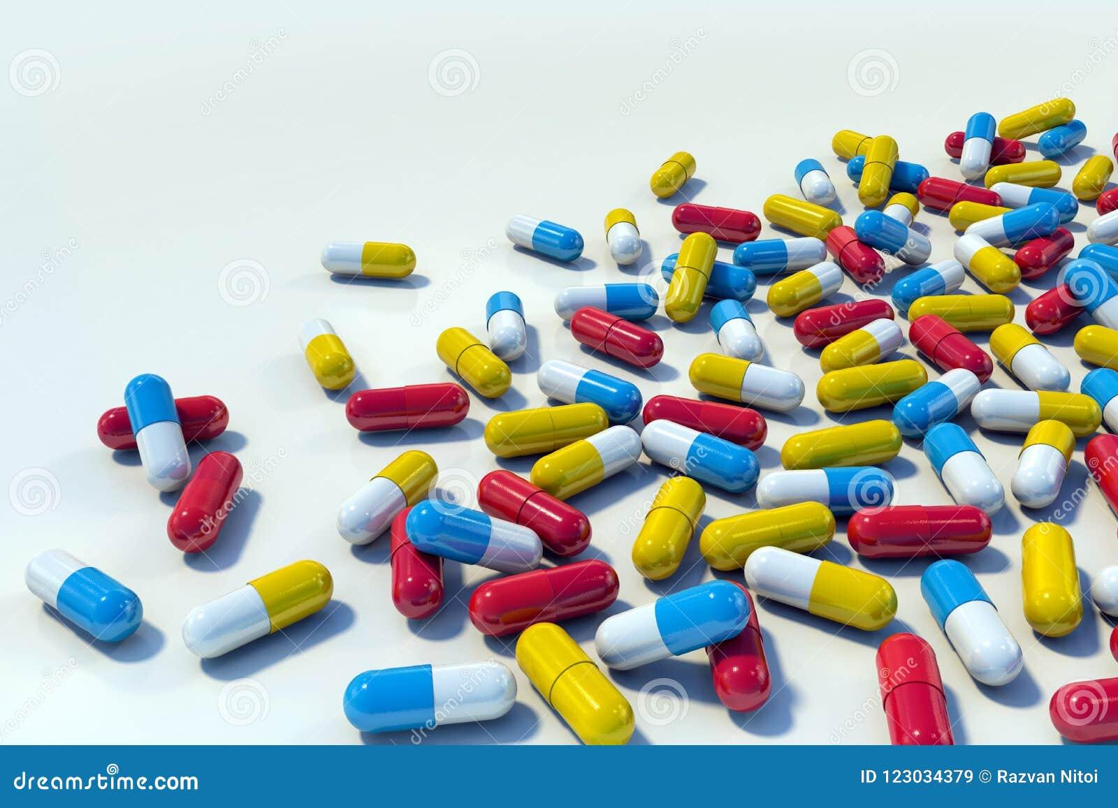 Kolorowe medycyn kapsuły na lekkim tle