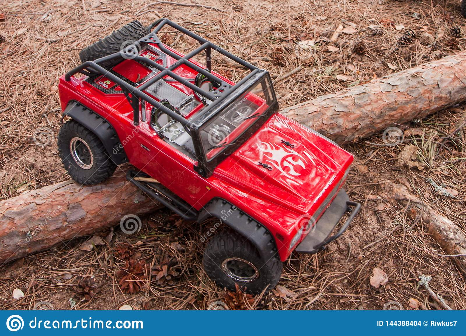 Kolyazin, Moscow region / Russian Federation - May 1 2014: RC car trophy crowler Jeep moves over an obstacle in the form