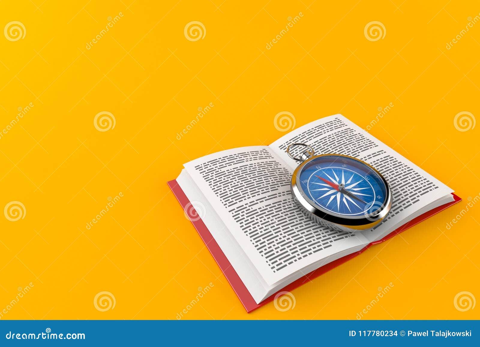 Kompass på den öppna boken