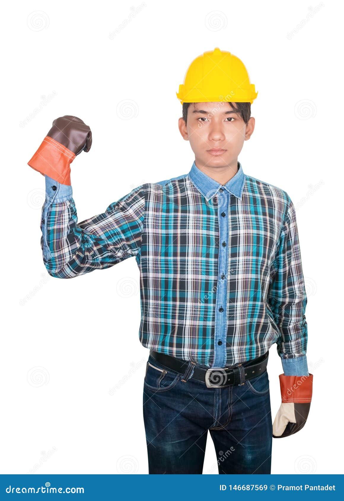 Konstruujący ręki pięści symbol jest ubranym koszulową błękitną i rękawiczkową skórę z żółtym zbawczego hełma klingerytem na kier