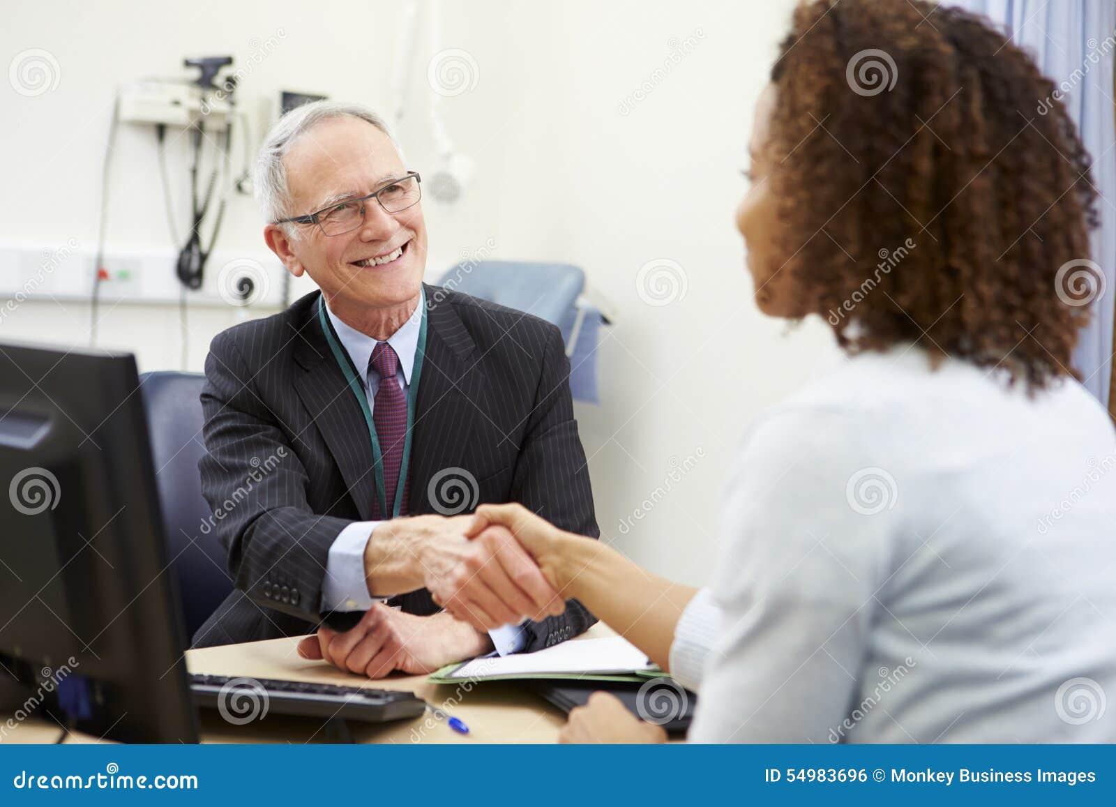 Konsulent Meeting With Patient i regeringsställning