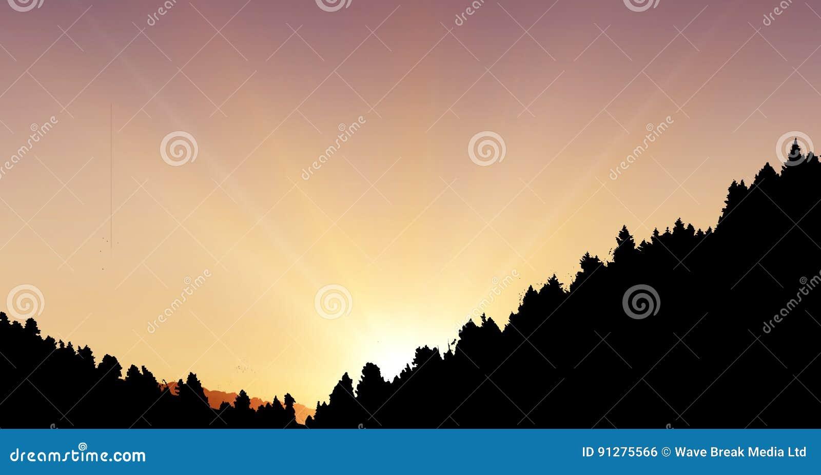 Konturkullar mot himmel under solnedgång
