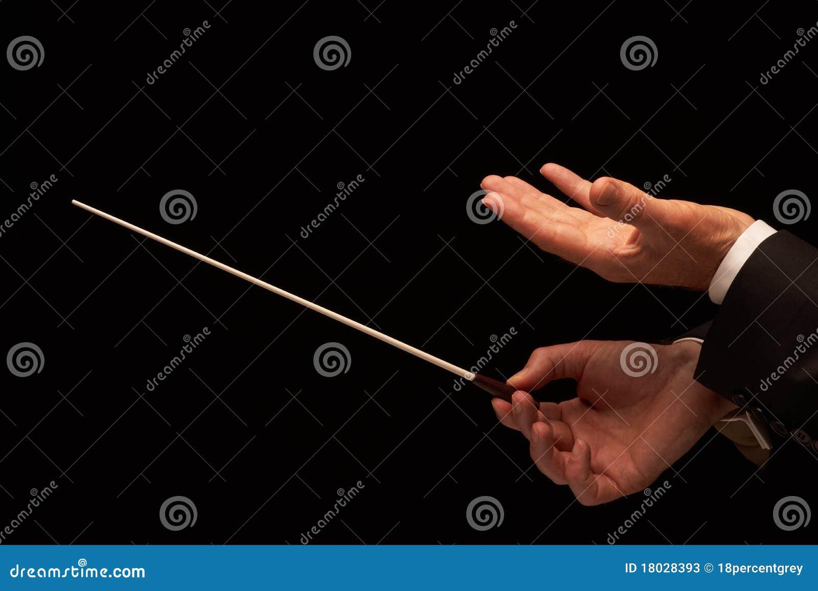 Konzertleiterhände mit Taktstock