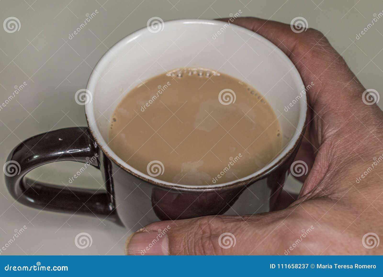 Kop met koffie met melk