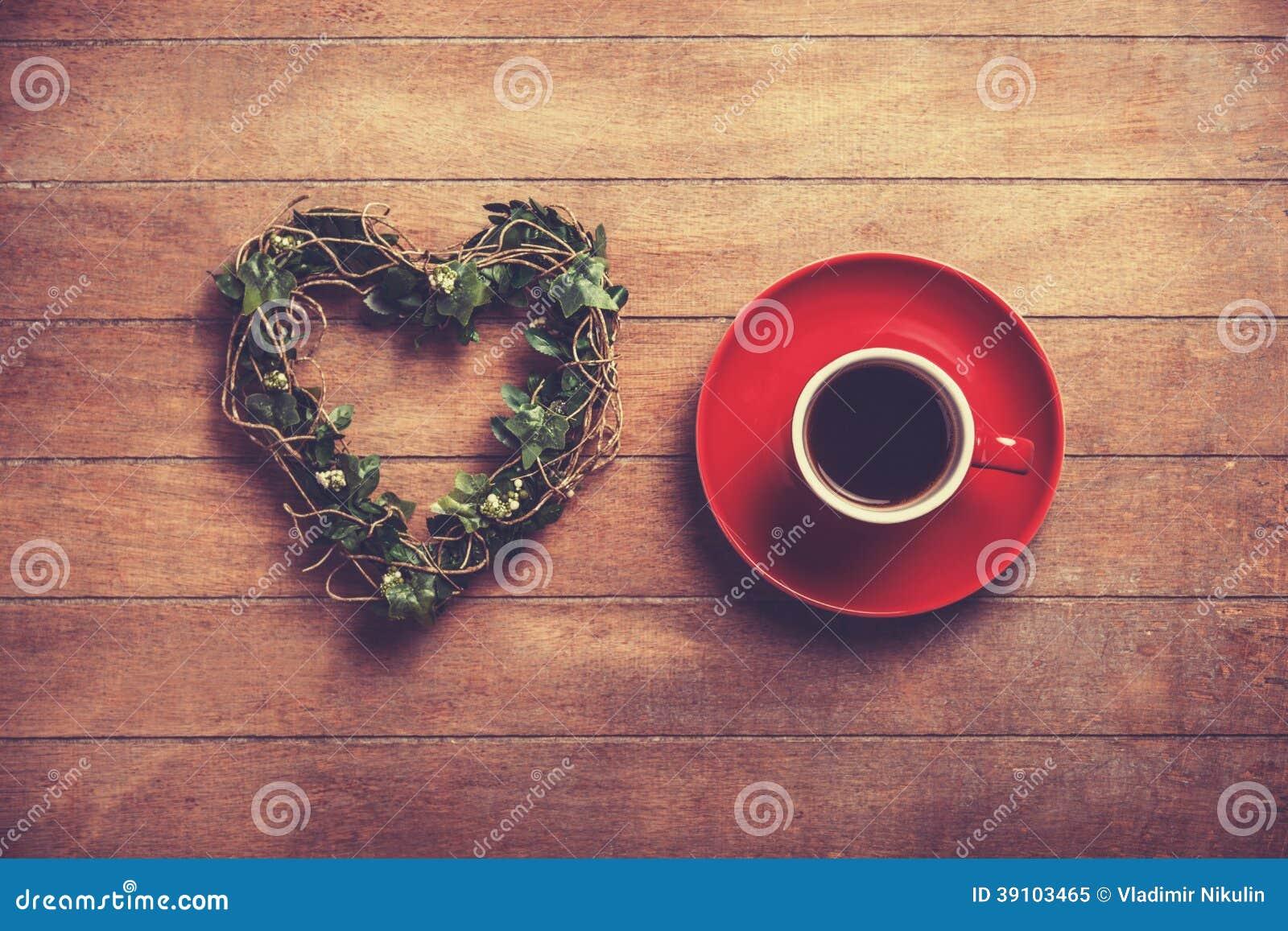 Kop van koffie en vormhart