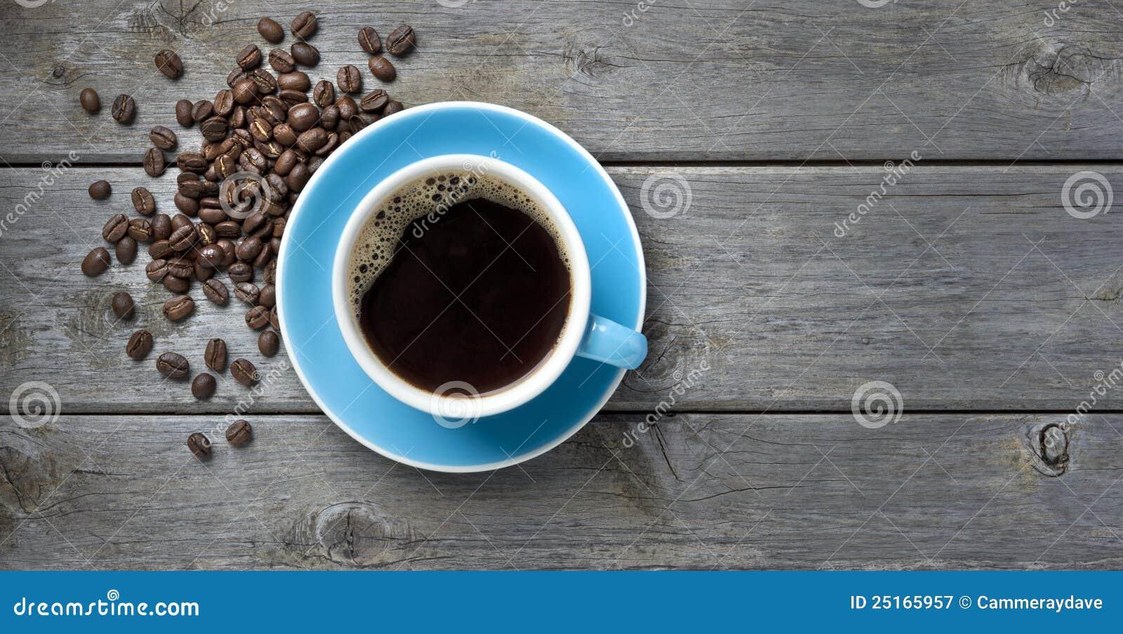 Kopp för bakgrundsbönakaffe