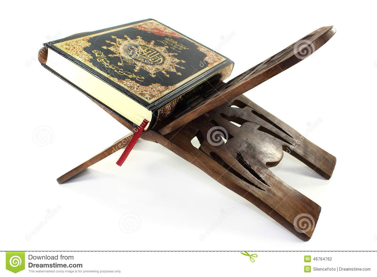 Quran with Quran wooden stand in front of white background.