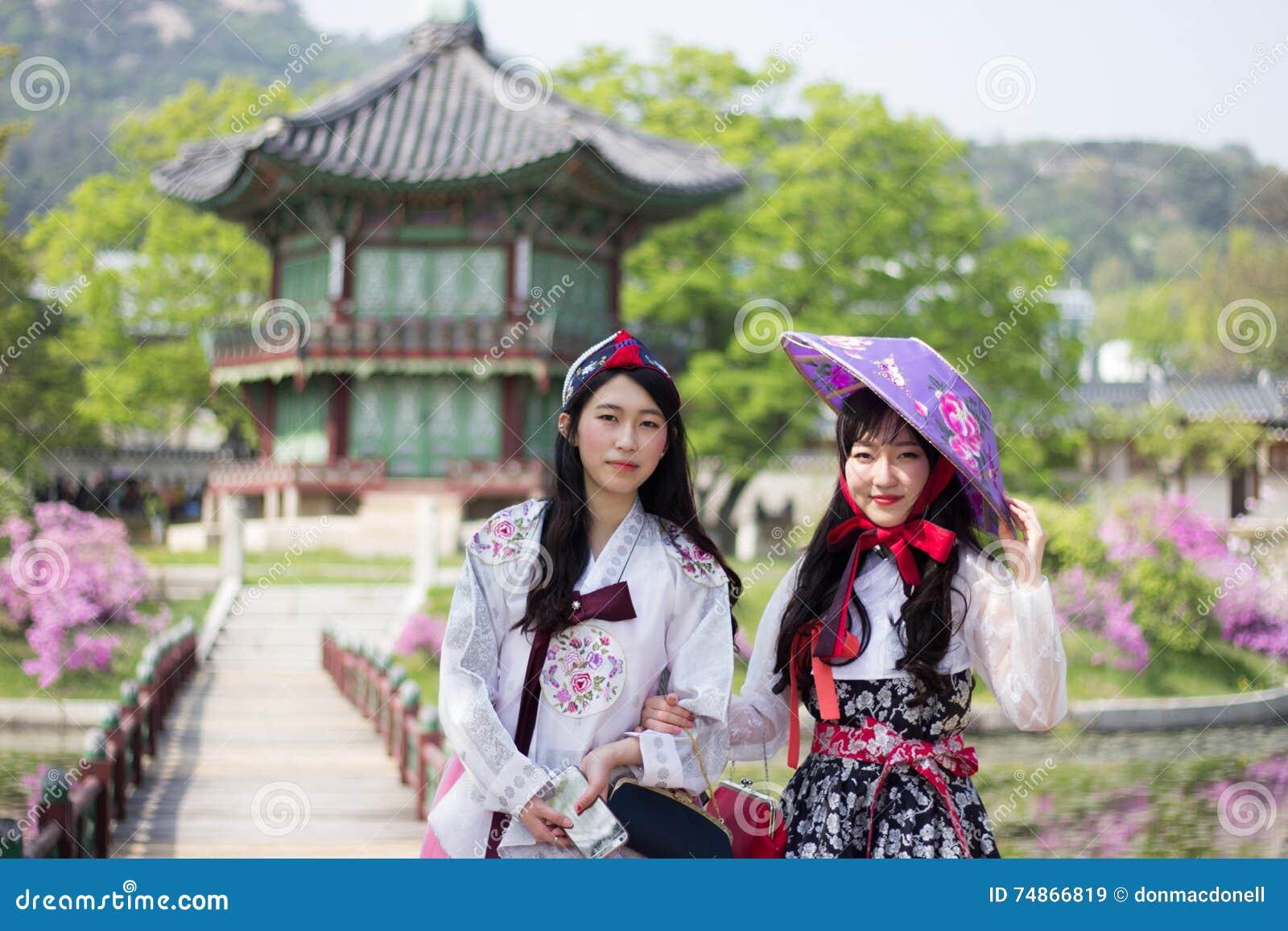 Korean women wearing hanbok at gyeongbokgung palaces pavilion korean women wearing hanbok at gyeongbokgung palace s pavilion seoul south korea sciox Image collections