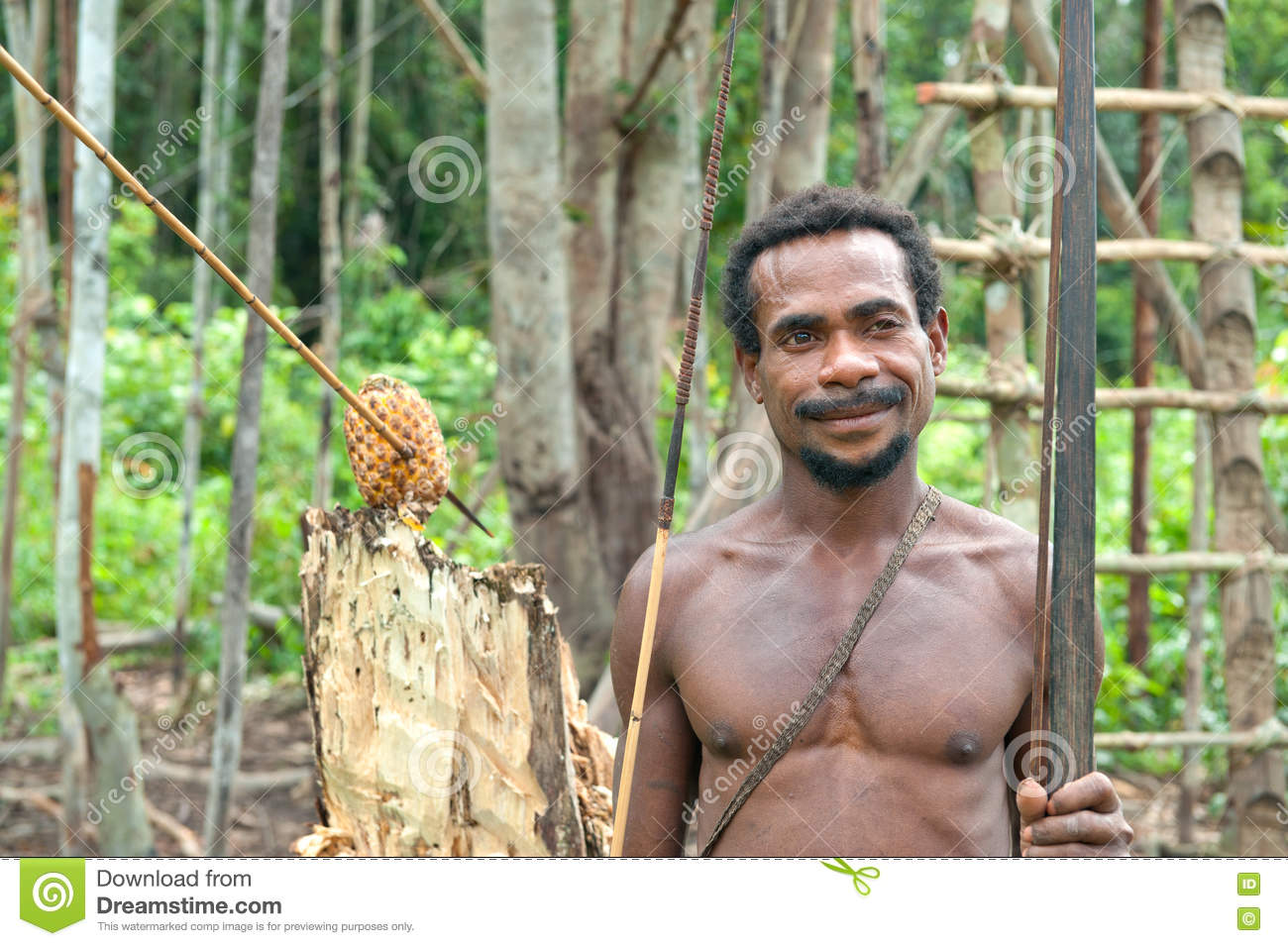 Korowai (Kolufo) Tribe Man With Bow And Arrows In The Wild Jungles