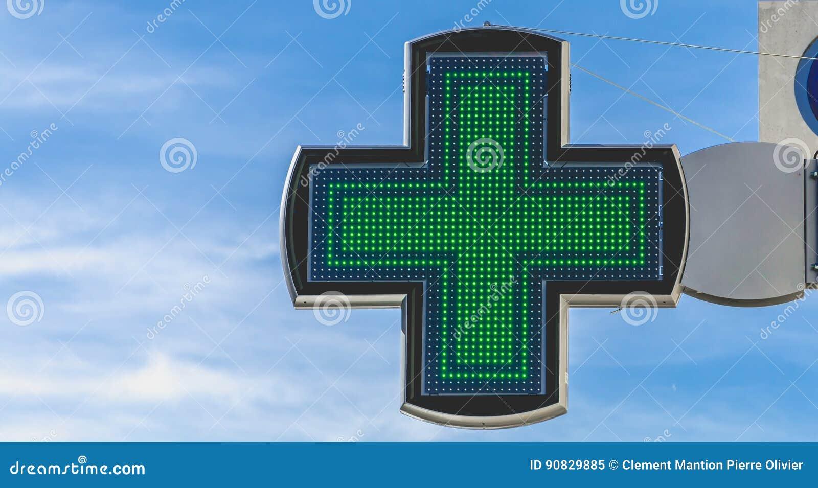 Kors av apotekelektronik på blå himmel