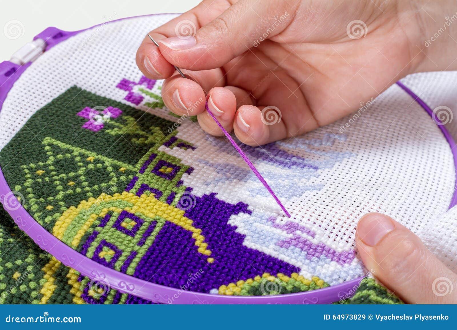 Korsstygn som är handgjord, handarbete