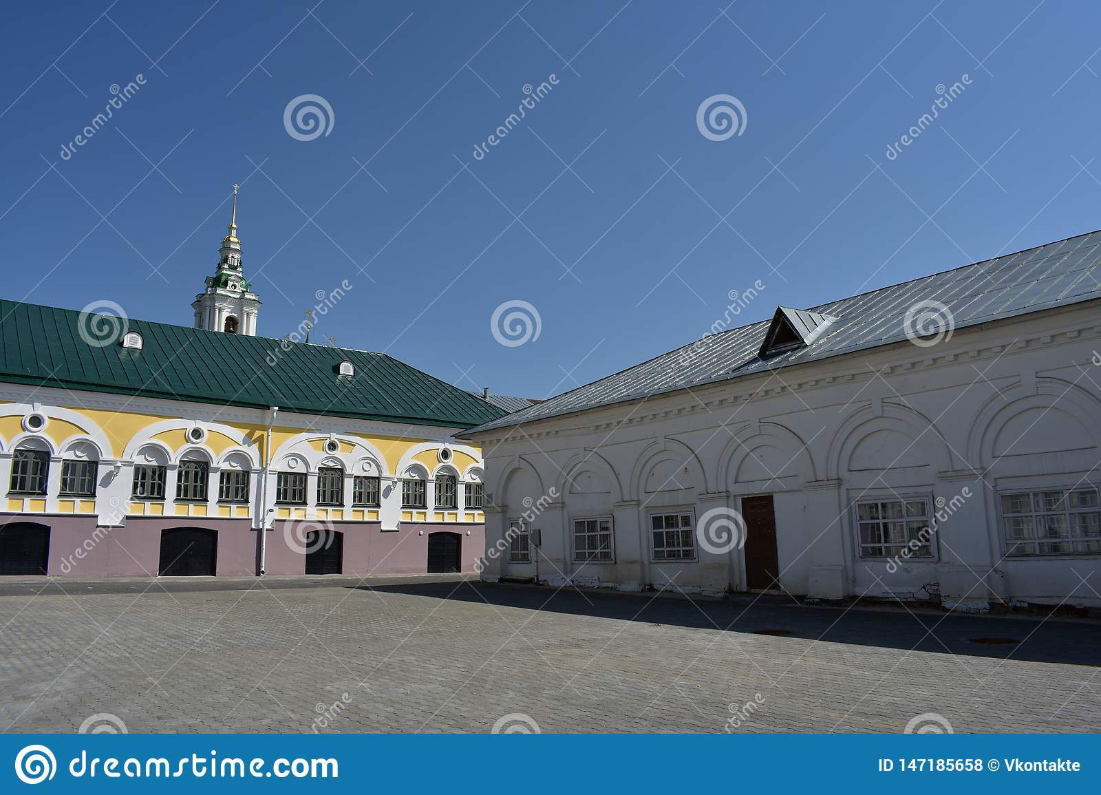 Kostroma beautiful view of the shopping arcade opens from the square, white arcade, bell tower and the dome of the Church
